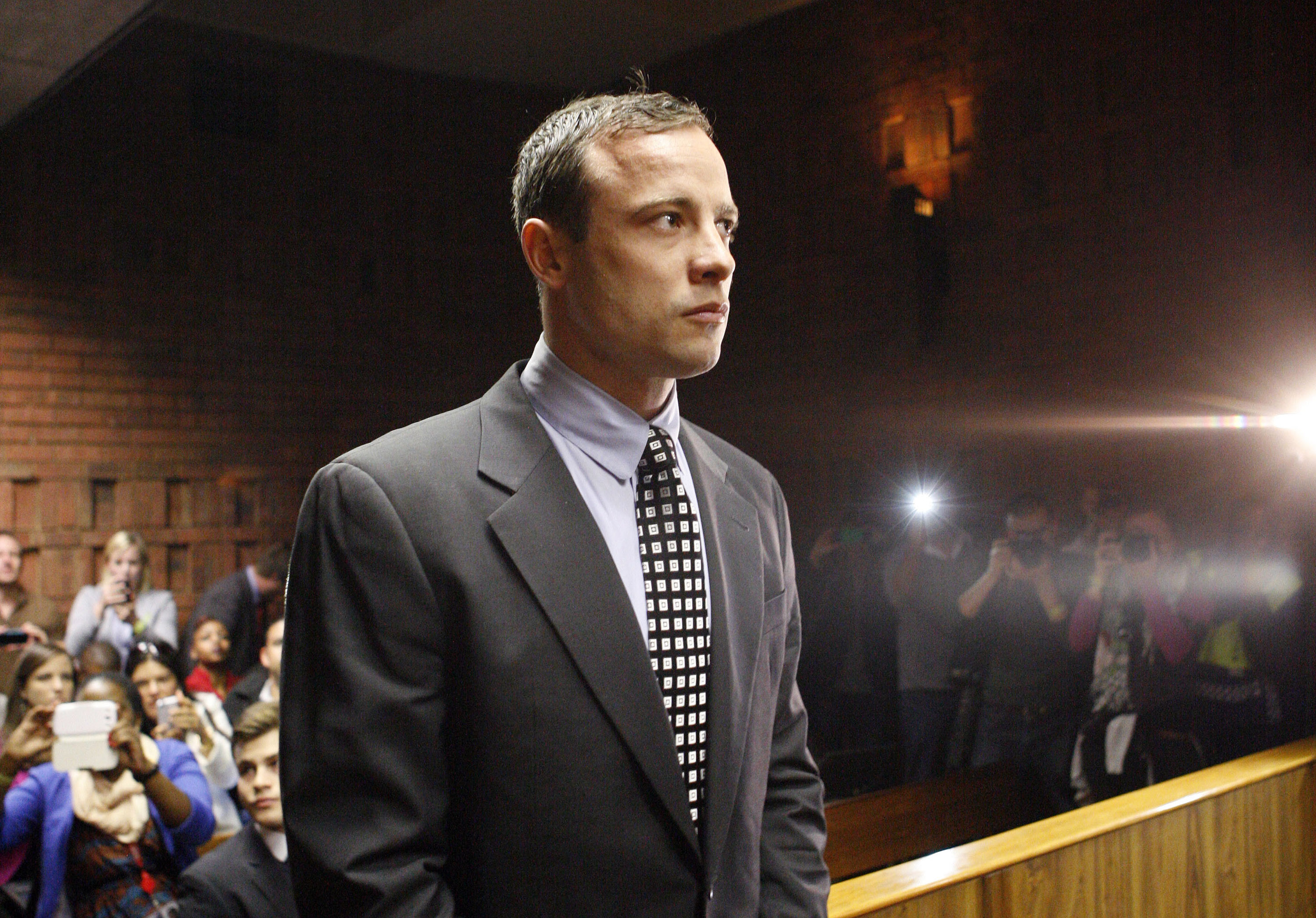 Double-amputee Olympian, Oscar Pistorius, looks on as he appears in the magistrates court in Pretoria, South Africa, Tuesday, June 4, 2013.
