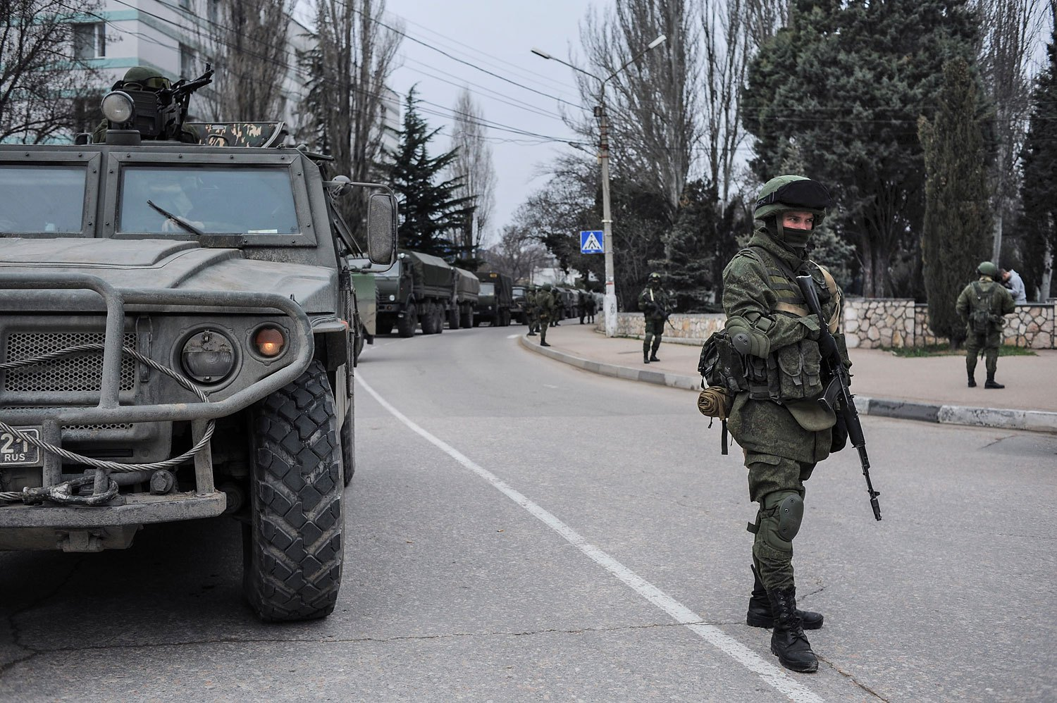 Troops in unmarked uniforms stand guard in Balaklava on the outskirts of Sevastopol, Ukraine, Saturday, March 1, 2014.