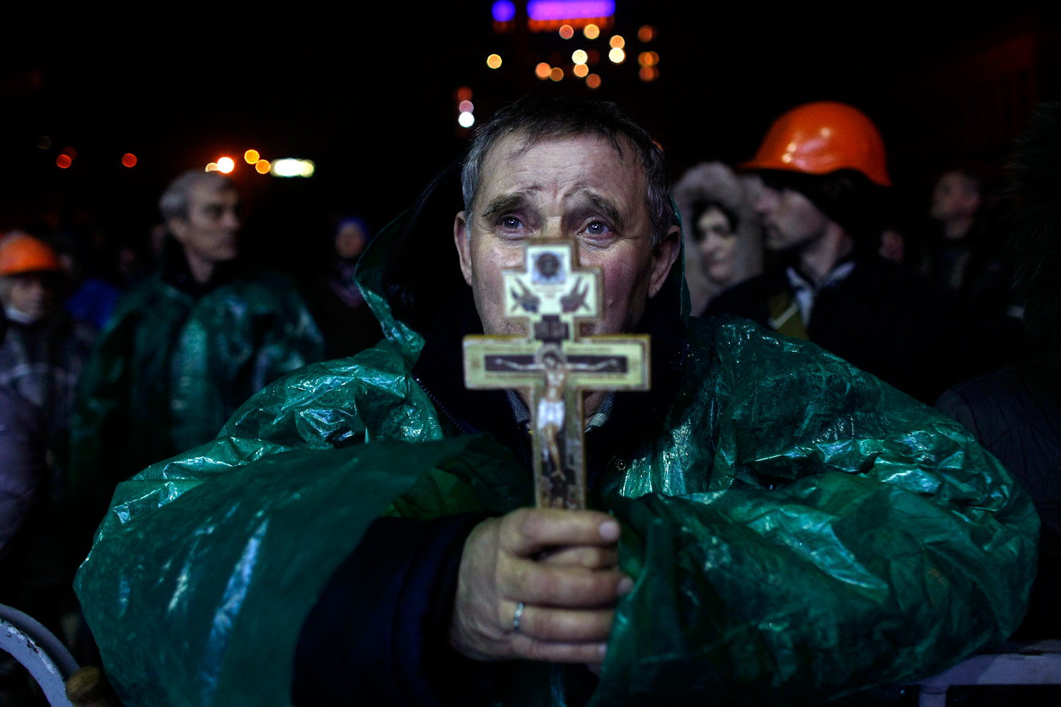 An anti-government protester holds a crucifix as he prays at Independence Square in Kiev, Ukraine, Feb. 20, 2014.