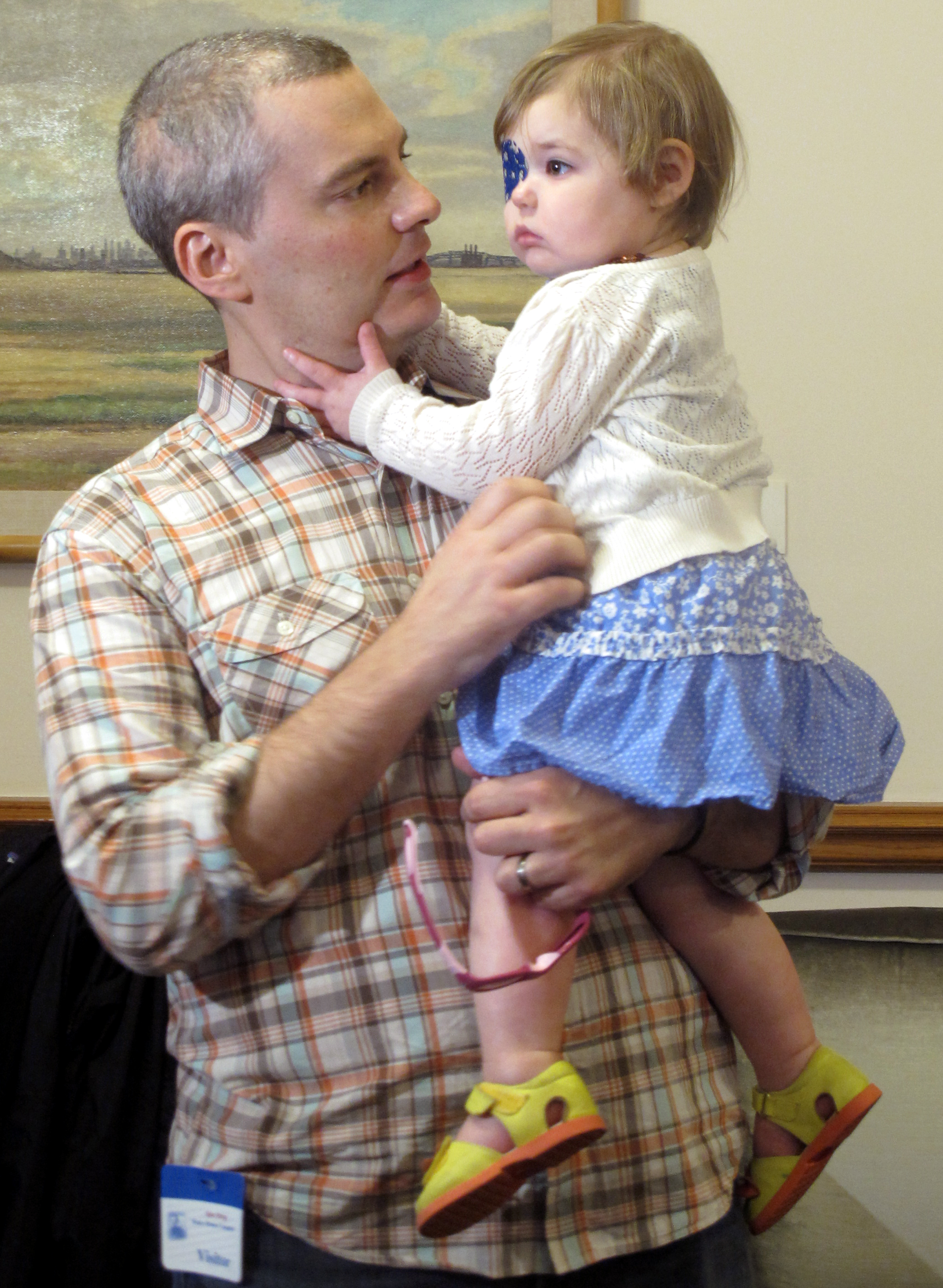 Brian Wilson, of Scotch Plains, N.J. holds his 2-year-old daughter Vivian.