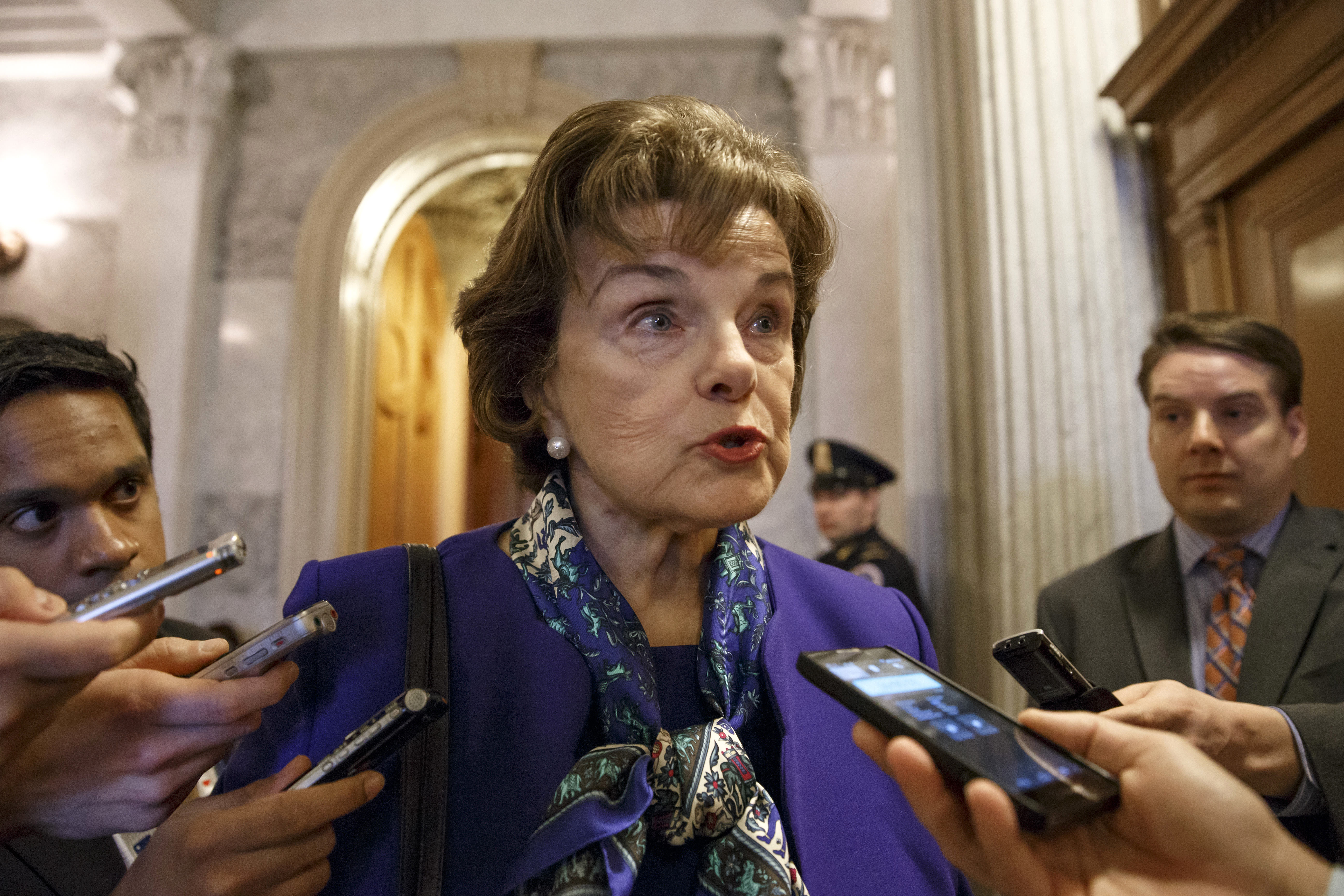 Senate Intelligence Committee Chair Senator Dianne Feinstein talks to reporters as she leaves the Senate chamber on Capitol Hill in Washington, Tuesday, March 11, 2014, after saying that the CIA's improper search of a stand-alone computer network established for Congress has been referred to the Justice Department. The issue stems from the investigation into allegations of CIA abuse in a Bush-era detention and interrogation program.