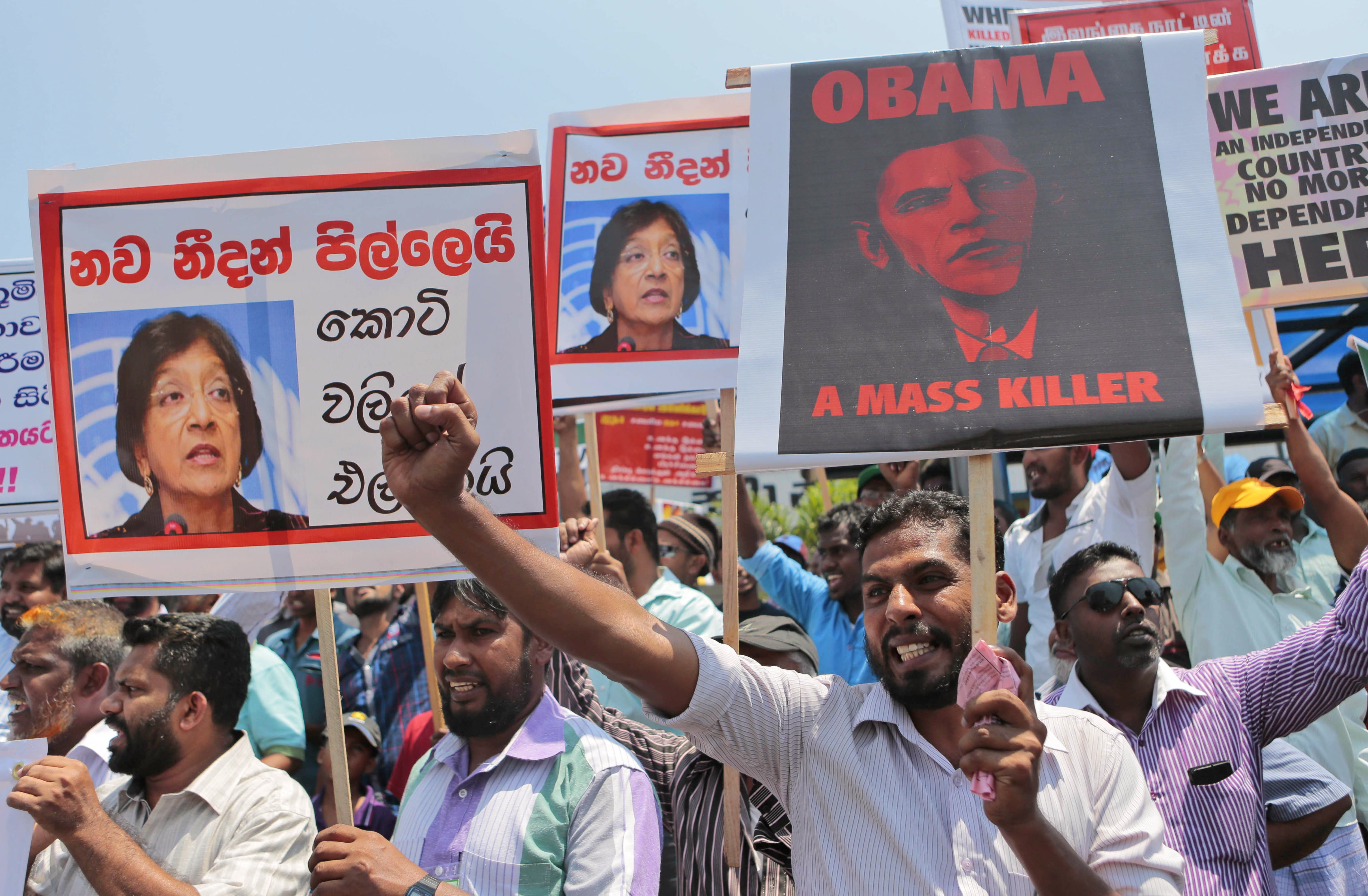 Sri Lankan government supporters demonstrate prior to the vote by the U.N. Human Rights Council