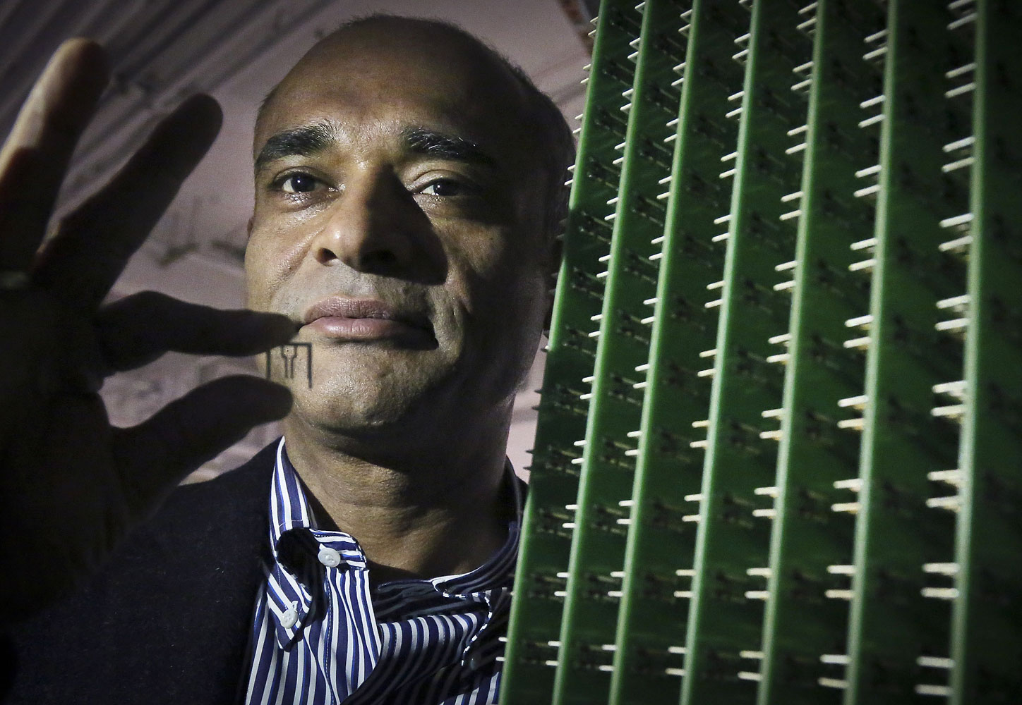 Chet Kanojia, founder and CEO of Aereo, Inc., stands next to a server array of antennas in New York, Dec. 20, 2012.