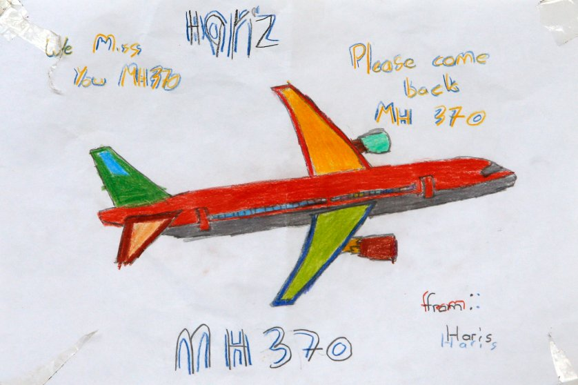 An artwork conveying well-wishes for the missing Malaysia Airlines Flight MH370 is seen in Kuala Lumpur International Airport