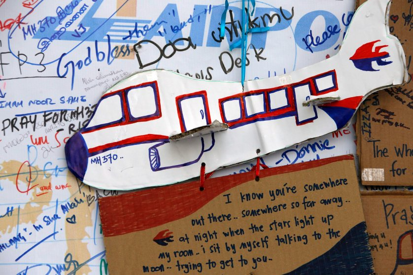 An artwork conveying well-wishes for missing Malaysia Airlines Flight MH370 is seen in Kuala Lumpur International Airport