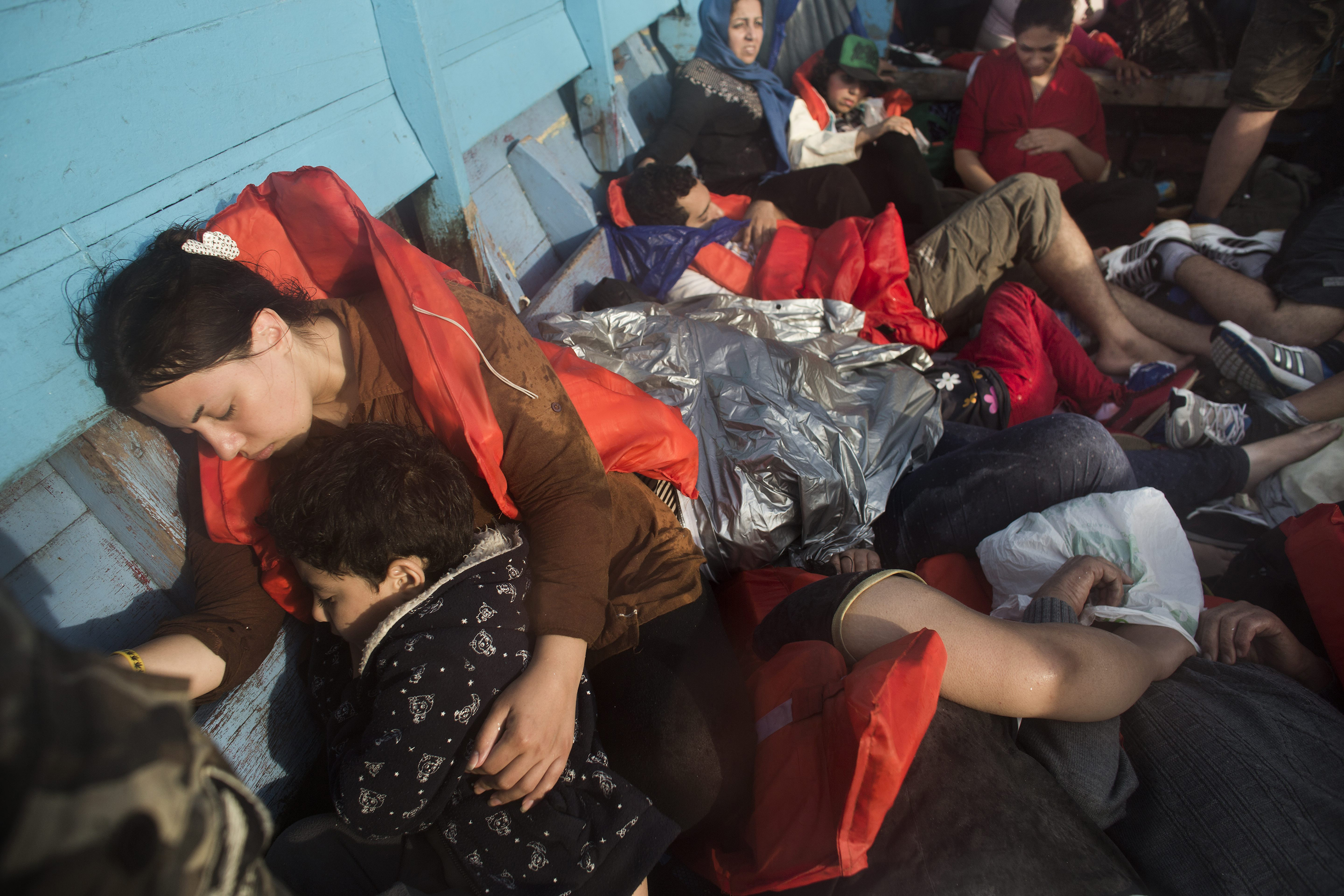 A group of asylum seekers—all Iranian except for one Afghan—en route by boat from Indonesia to Australia on Sept. 7, 2013.