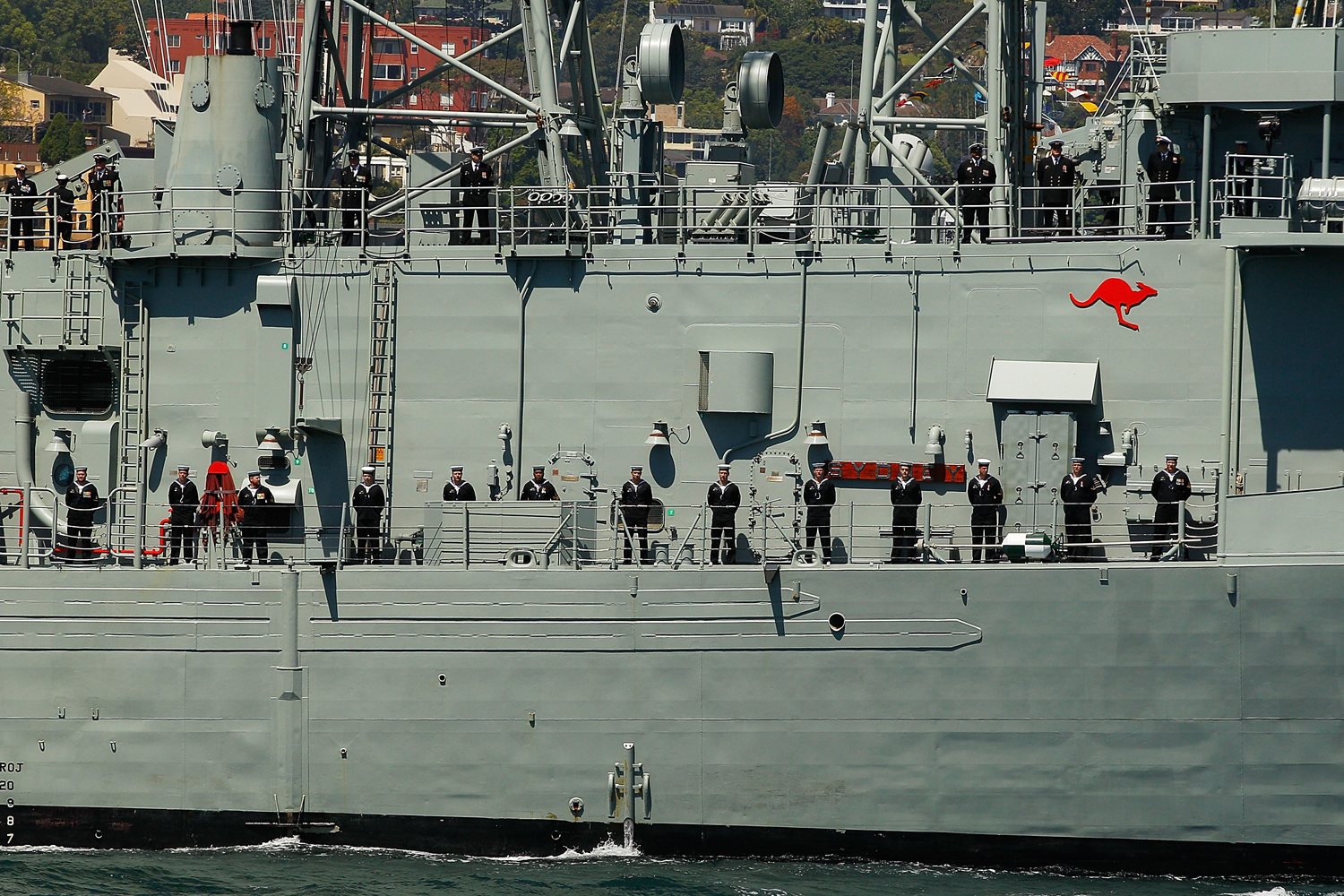 Sailors aboard the HMAS Darwin stand in formation on Oct. 5, 2013 in Sydney, Australia