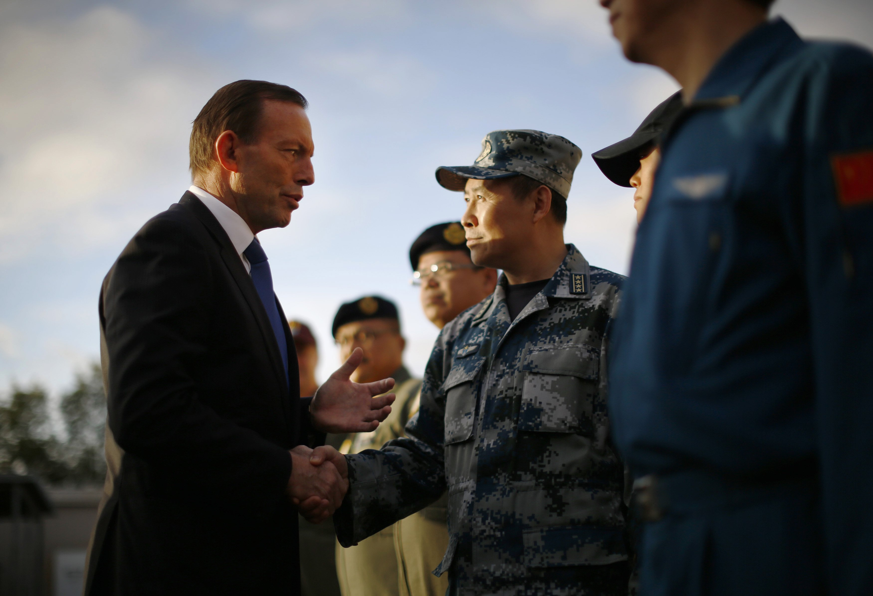 Australian Prime Minister Tony Abbott speaks with China's Air Force Senior Colonel Liu Dian Jun, head of China's effort to locate Malaysia Airlines flight MH370, during his visit to RAAF Base Pearce on March 31, 2014 in Perth, Australia.