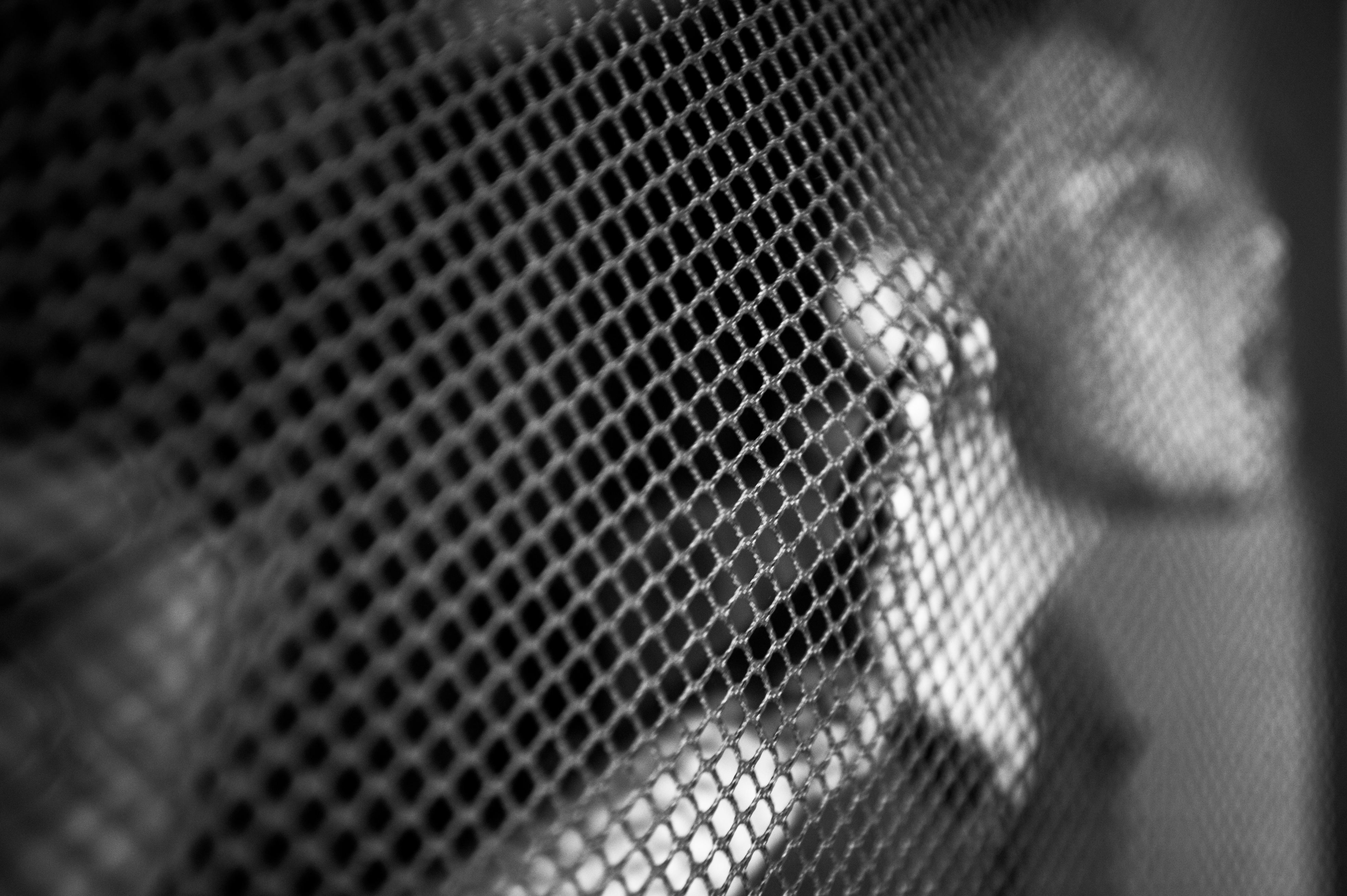 Marcus O'Loughlin, 8, tries to breathe through the mesh of a bouncy castle at the WakeMed Soccer Park during a birthday party for his brother, Brendan O'Loughlin, 6. Marcus has severe sensory issues, so the feeling of the mesh helped him focus and stay calm in an otherwise over-stimulating environment.