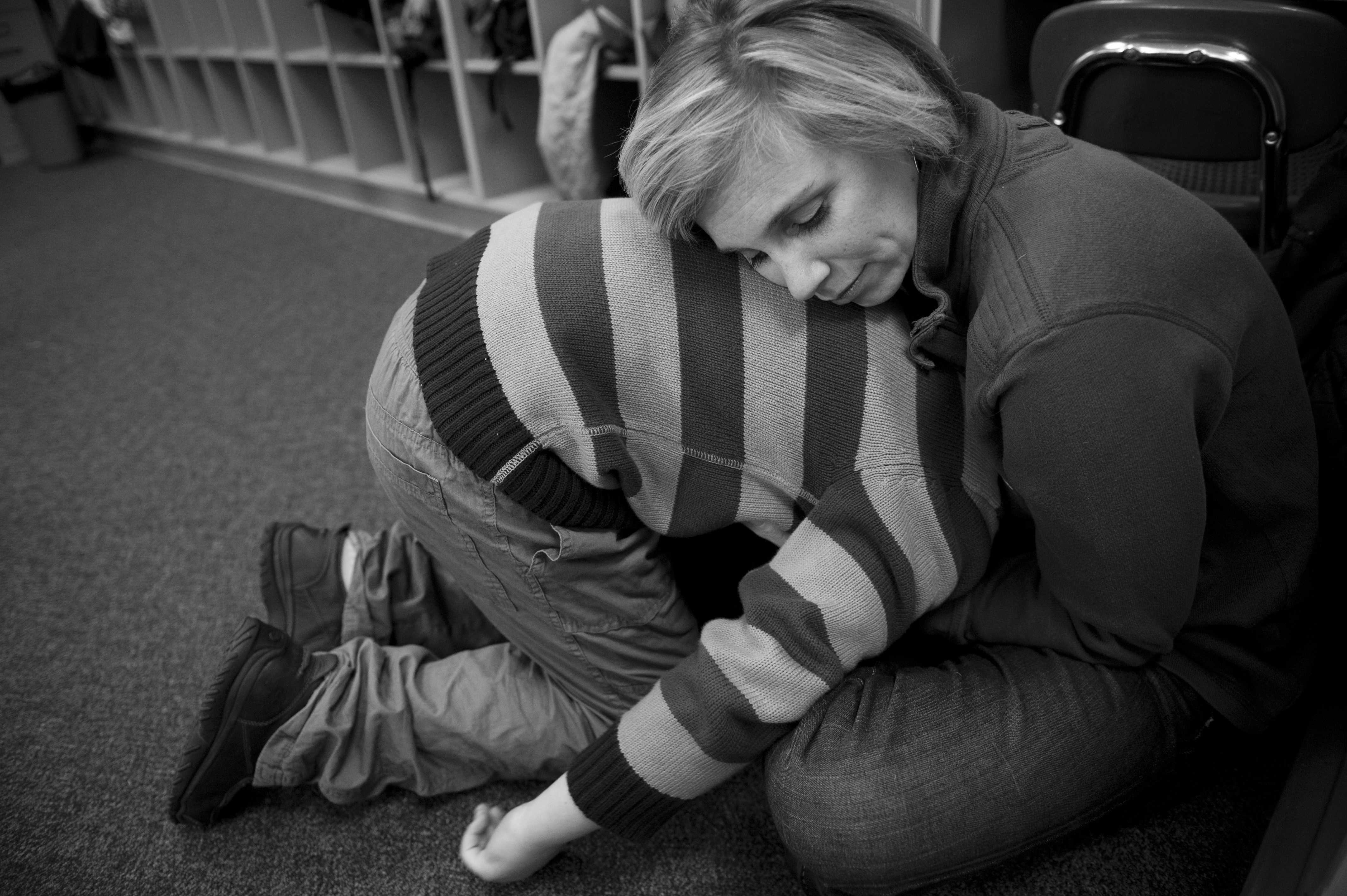 Erin and Marcus share a moment at school before she leaves his classroom at Middle Creek Elementary in Apex, N.C. He always gets upset when she leaves him in the morning.