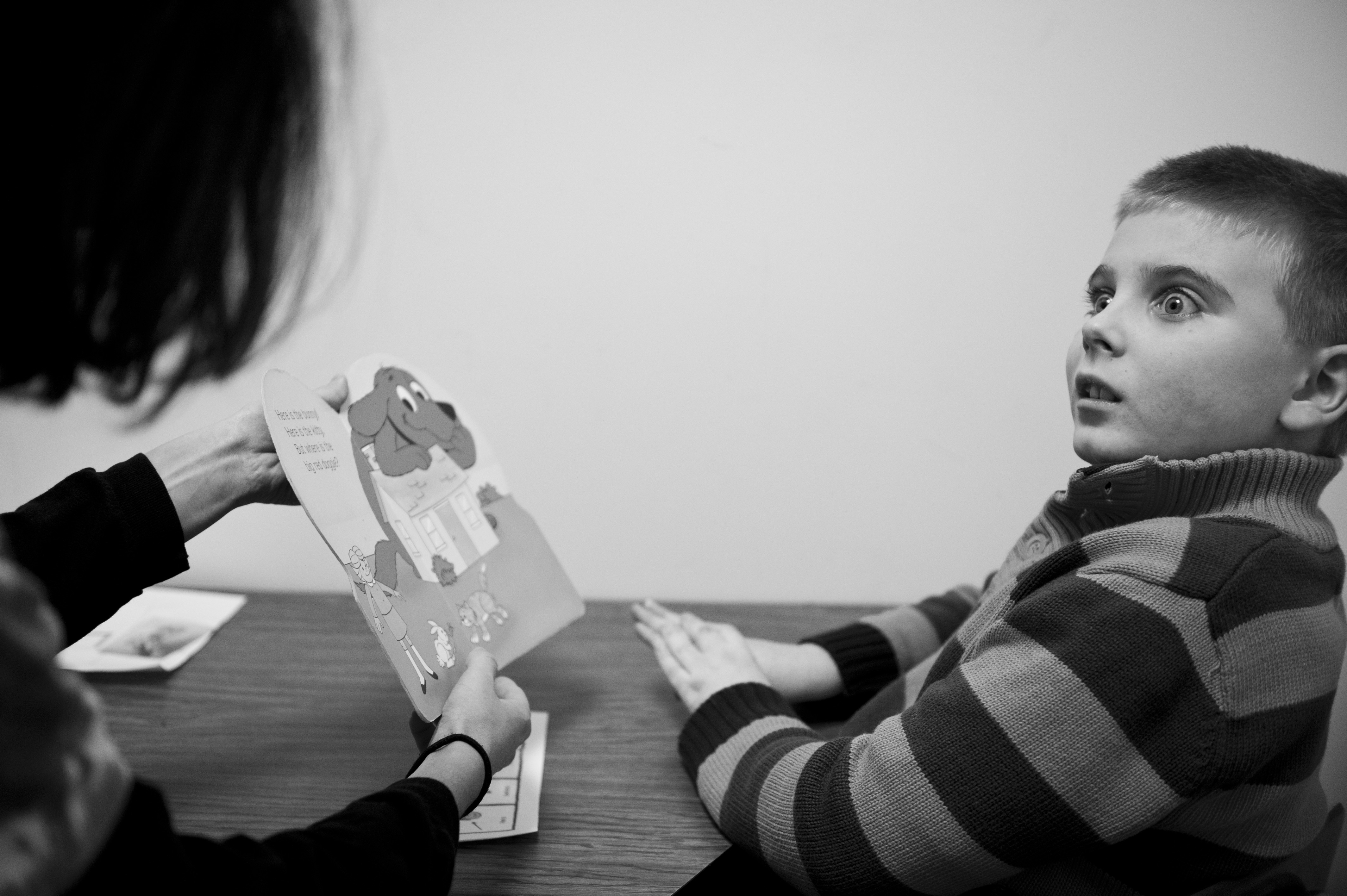 Marcus reacts to his teacher during a one-on-one reading session.