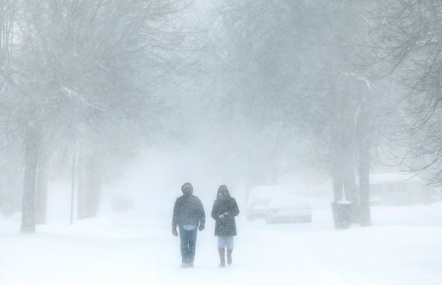 Pedestrians during a snow storm in Detroit, March 12, 2014. Another winter storm is expected from Missouri to Delaware on Sunday.