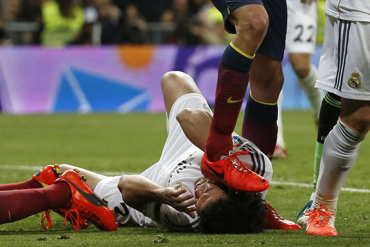 Mar. 23, 2014.  Barcelona's Sergio Busquets steps on a Real Madrid player Lionel Messi's scored a goal against him during La Liga's second 'classic' soccer match of the season at Santiago Bernabeu stadium in Madrid.