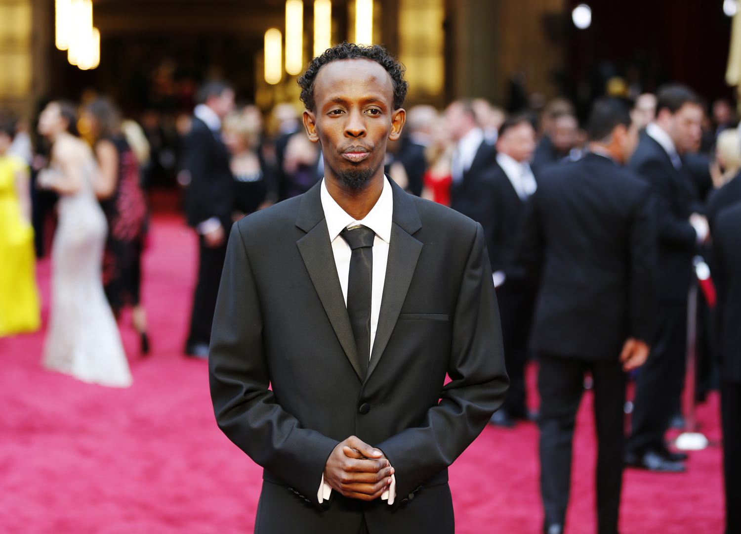 Barkhad Abdi, best supporting actor nominee for his role in Captain Phillips, arrives at the 86th Academy Awards in Hollywood, California March 2, 2014