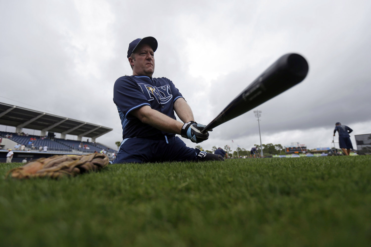 Mar. 25, 2014. Double amputee Dave Stevens, of Bristol, Conn., who will be throwing out the first pitch, swings a bat before an exhibition game between the Tampa Bay Rays and the Boston Red Sox in Port Charlotte, Fla.