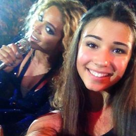 "A 15-year-old Australian girl snapped this lucky selfie with Beyonce during a concert in October. While originally hailed as a photobomb it was later revealed that the teen ""asked"" Beyonce to pose with her."