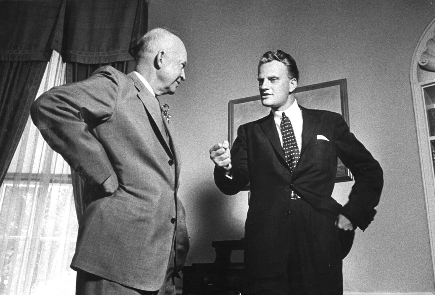 Ike                                                              Graham speaks with President Dwight Eisenhower at the White House, May 11, 1957.