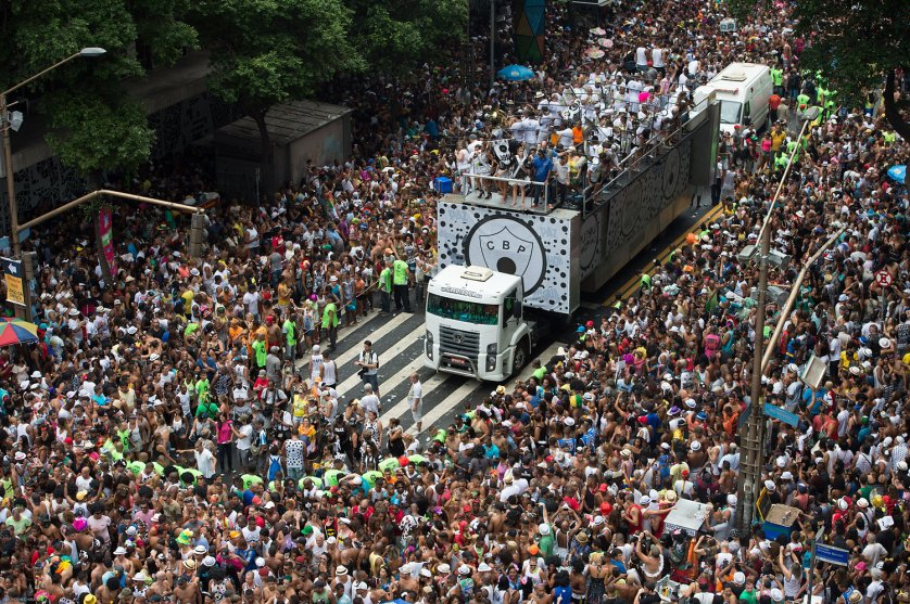 "Revellers take part in the ""Cordao da Bola Preta,"" the biggest street carnival band parade in downtown Rio de Janeiro, March 1, 2014."