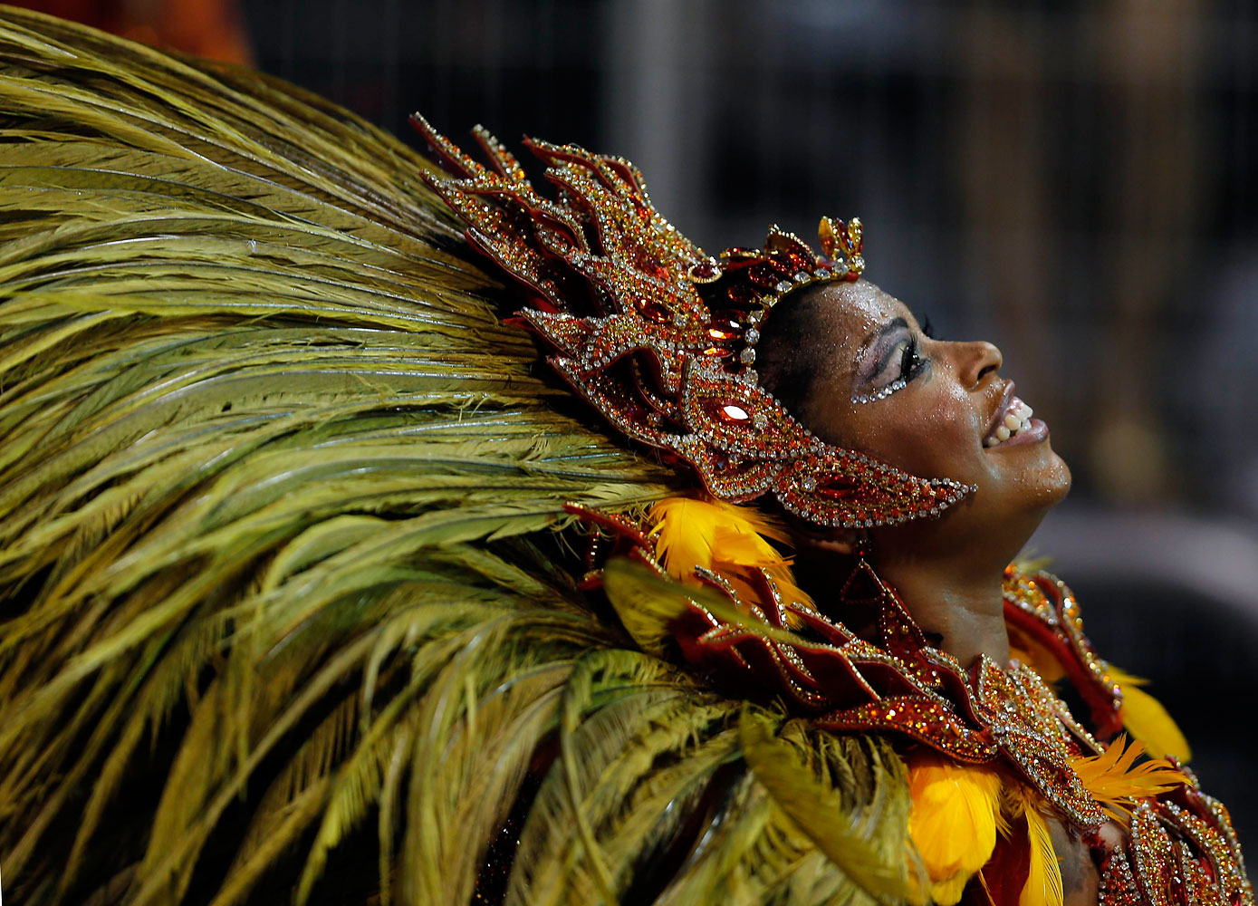 A reveller from the Vai Vai samba school takes part in the first night of the Special Group category of the annual Carnival parade in Sao Paulo's Sambadrome, March 1, 2014.