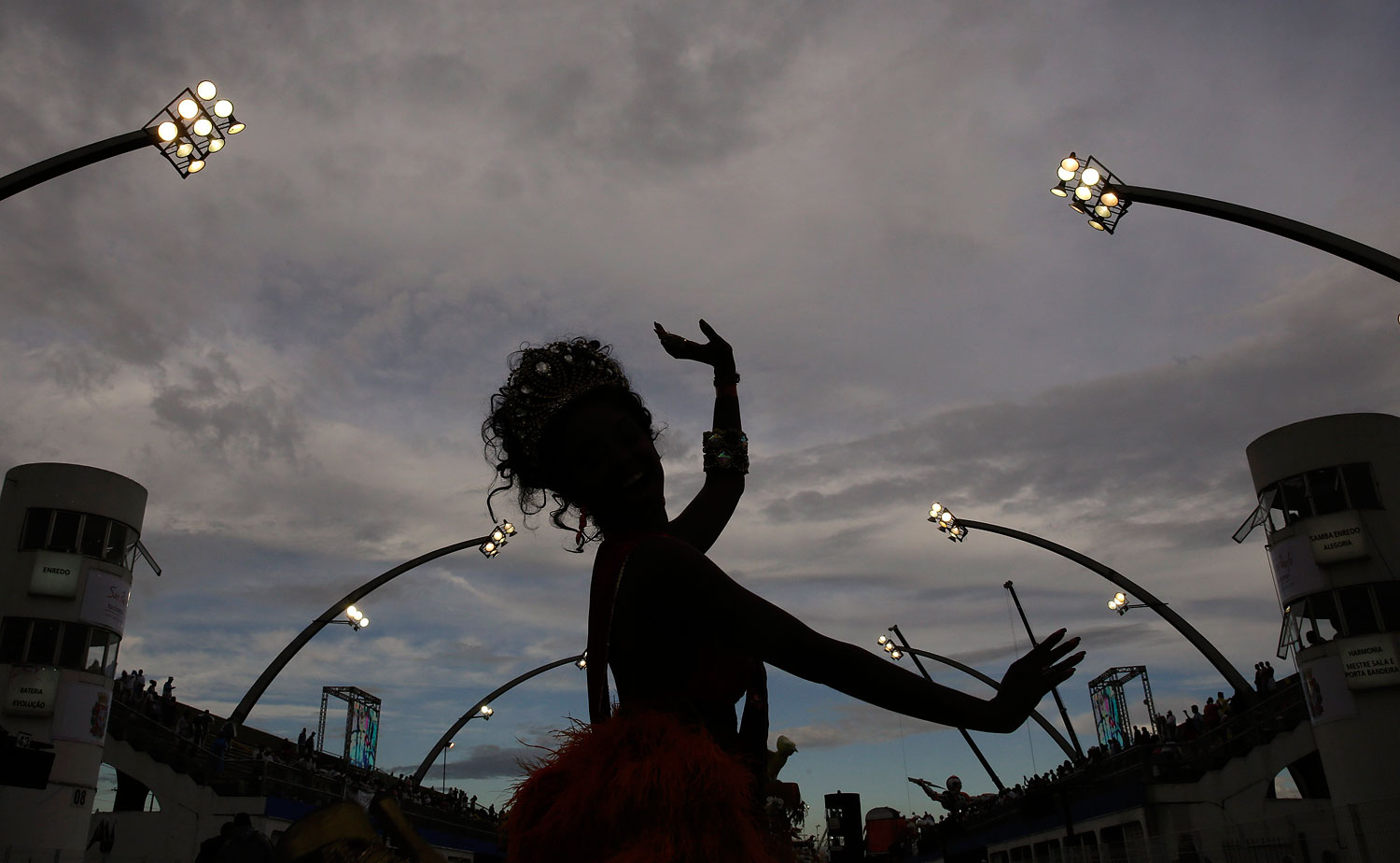 A dancer from the Tom Maior samba school performs during a carnival parade in Sao Paulo, Brazil, Saturday, March 1, 2014.