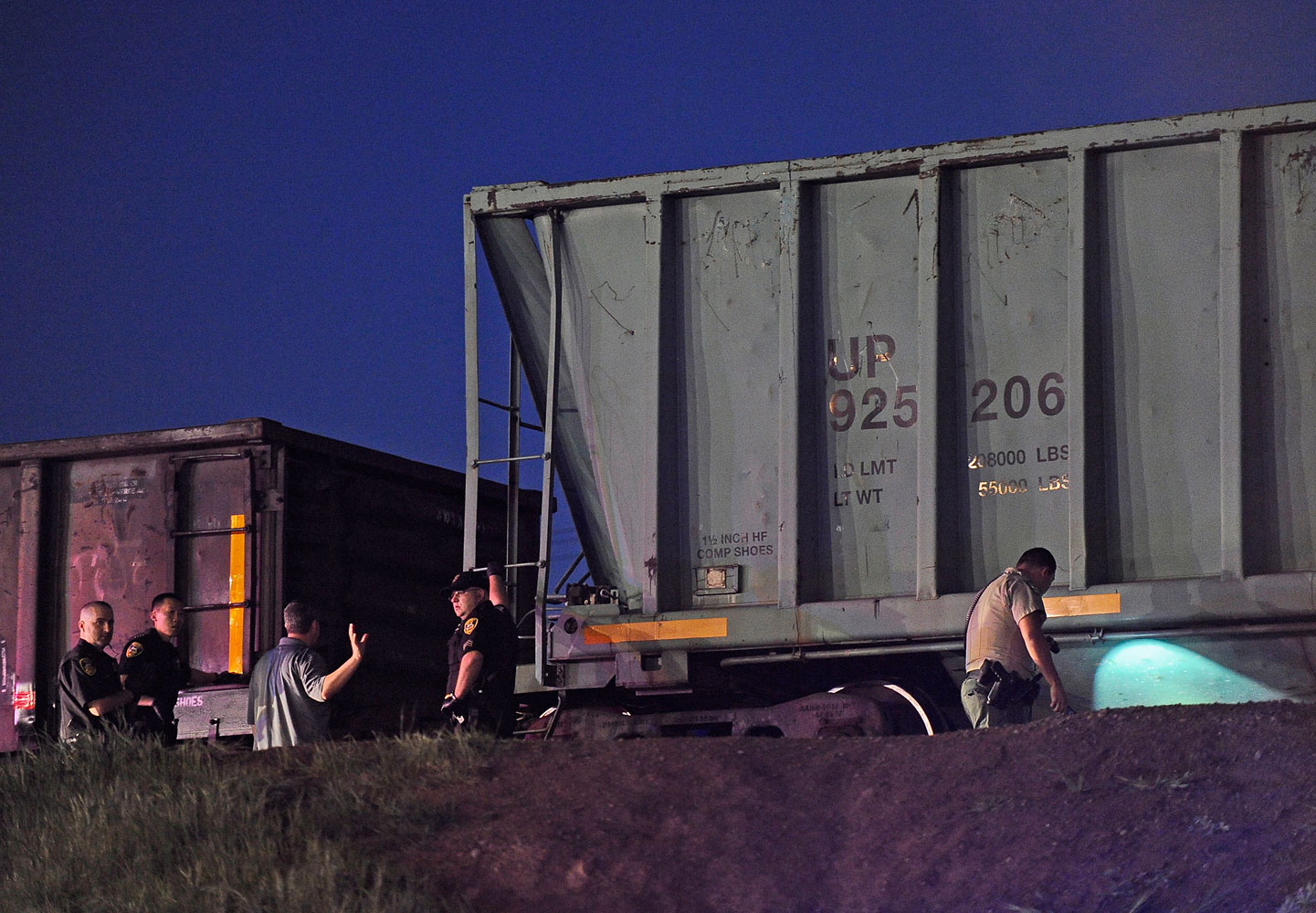 Emergency personnel work at the scene of a train accident near Earl Yorton Field Friday, March 21, 2014 in Marysville.