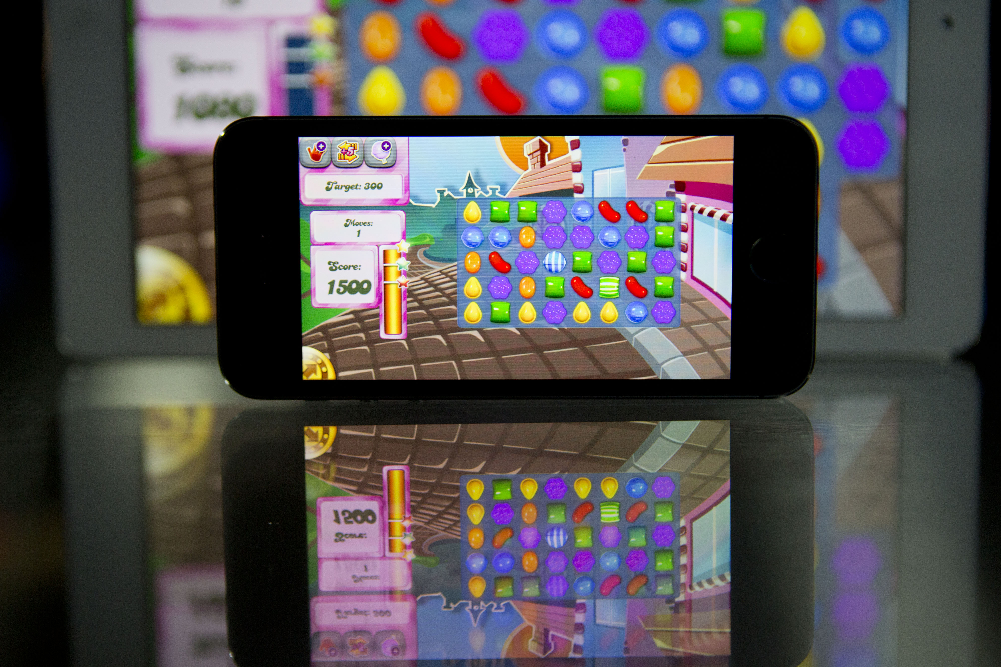 The  Candy Crush Saga  game is displayed on an Apple Inc. iPhone 5s and iPad Air in this arranged photograph in Washington, D.C., U.S., on Tuesday, Feb. 18, 2014.