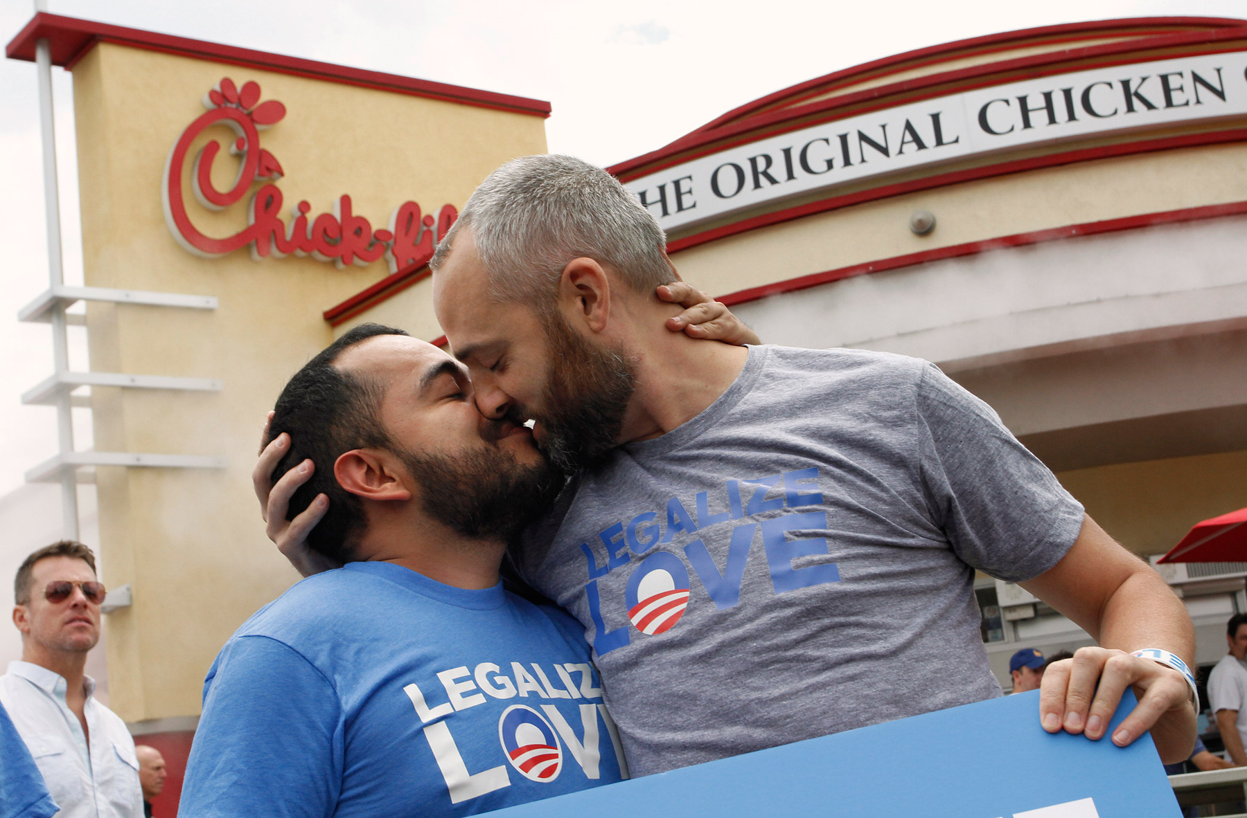 Eduardo Cisneros,left, and Luke Montgomery kiss on national  kiss-in  day at a Chick-fil-A restaurant in Hollywood, California, August 3, 2012.