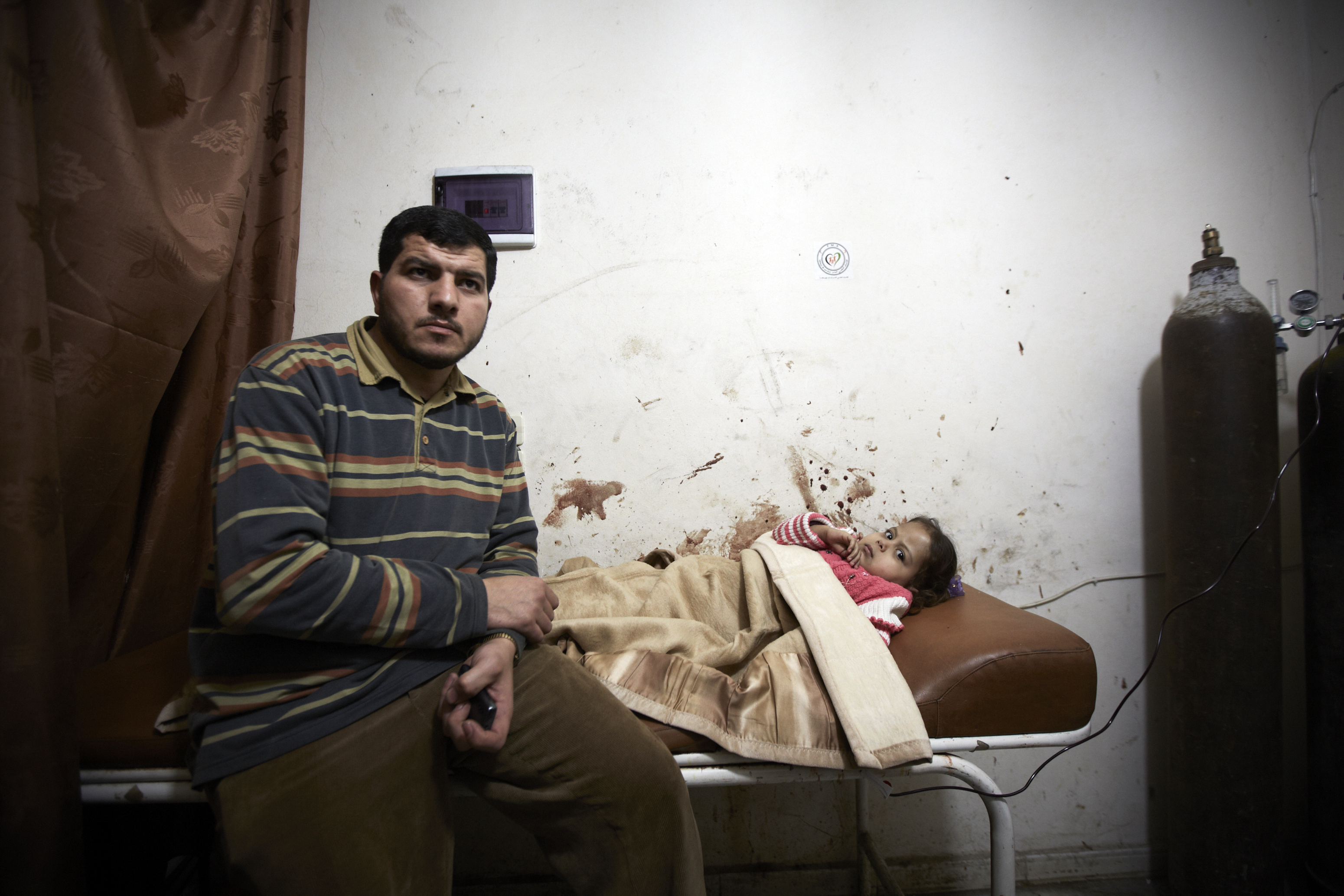 A wounded child is treated in a make shift hospital in Aleppo after her home was randomly targeted by the regime's artillery, on March 15, 2013.