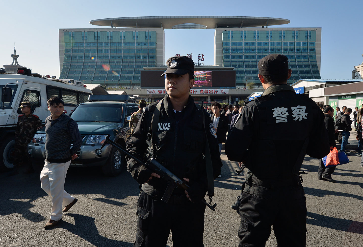 Chinese paramilitary police stand guard outside the scene of the terrorist attack at the main train station in Kunming, in the Chinese province of Yunnan, on March 3, 2014