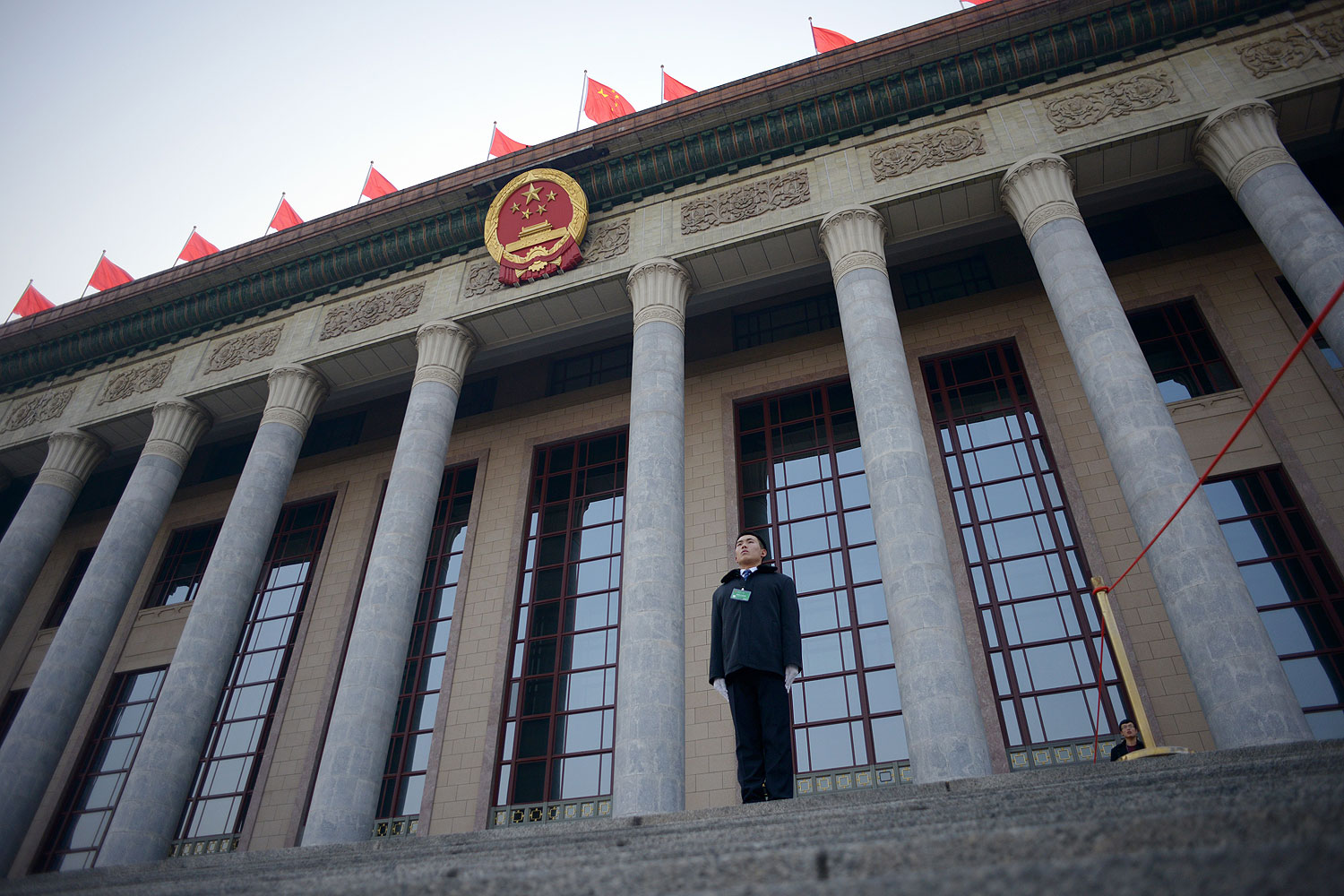 A security guard stands in front of The Great Hall of the People before the upcoming opening sessions of the National People's Congress (NPC) in Beijing on Mar. 2, 2014