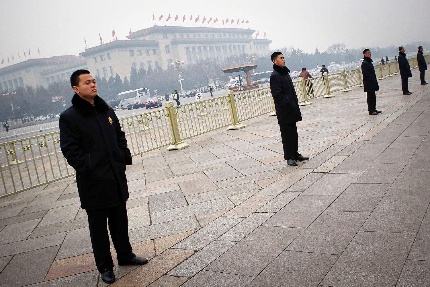 Chinese security guards stand in line in Tiananmen Square in Beijing, on March 3, 2014. Beijing has stepped up security for the NPC and CPPCC sessions this week