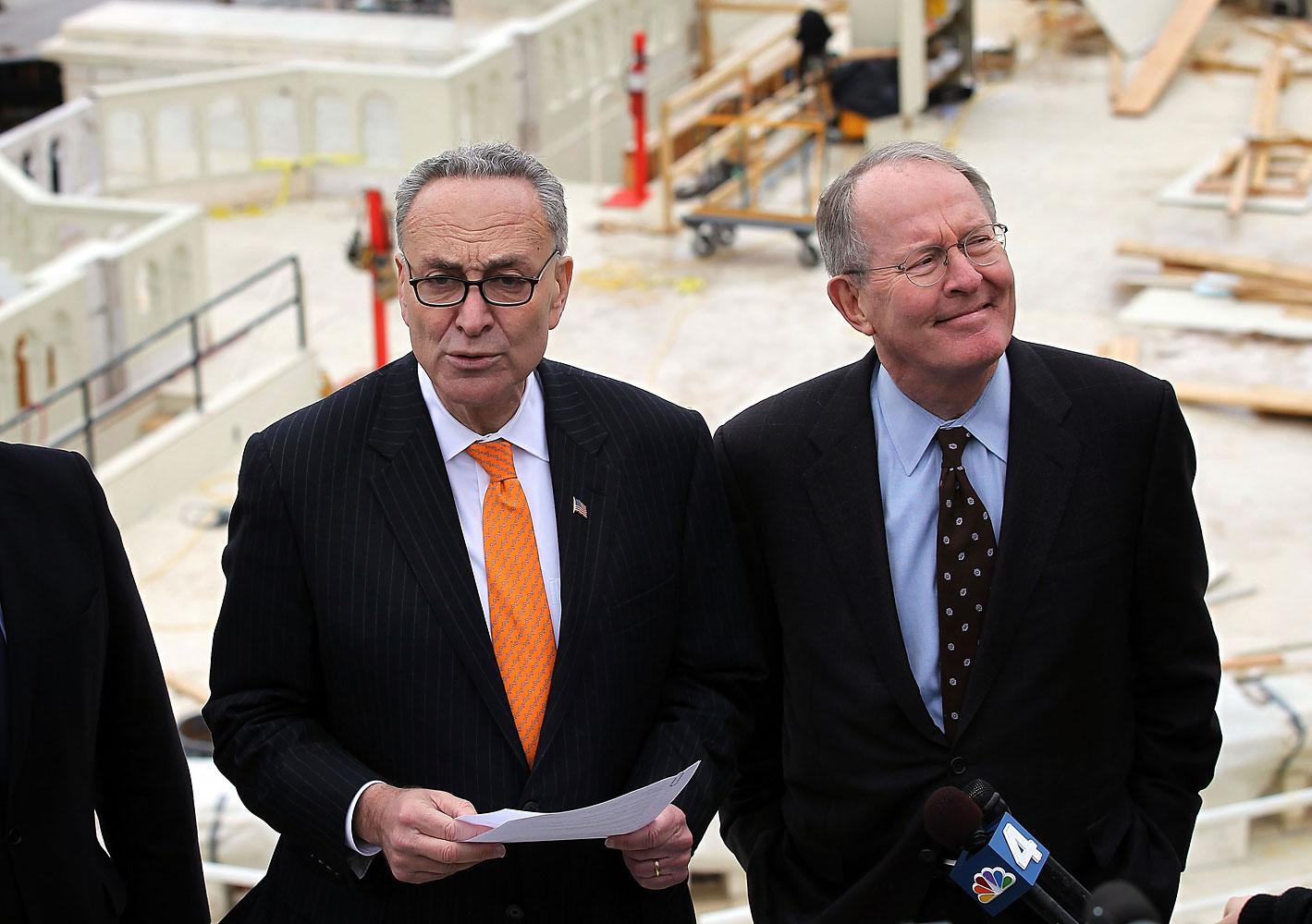 U.S. Senators Charles Schumer (D-NY) (L) and Lamar Alexander (R-TN) (R),  on Capitol Hill in Washington, DC in 2012.