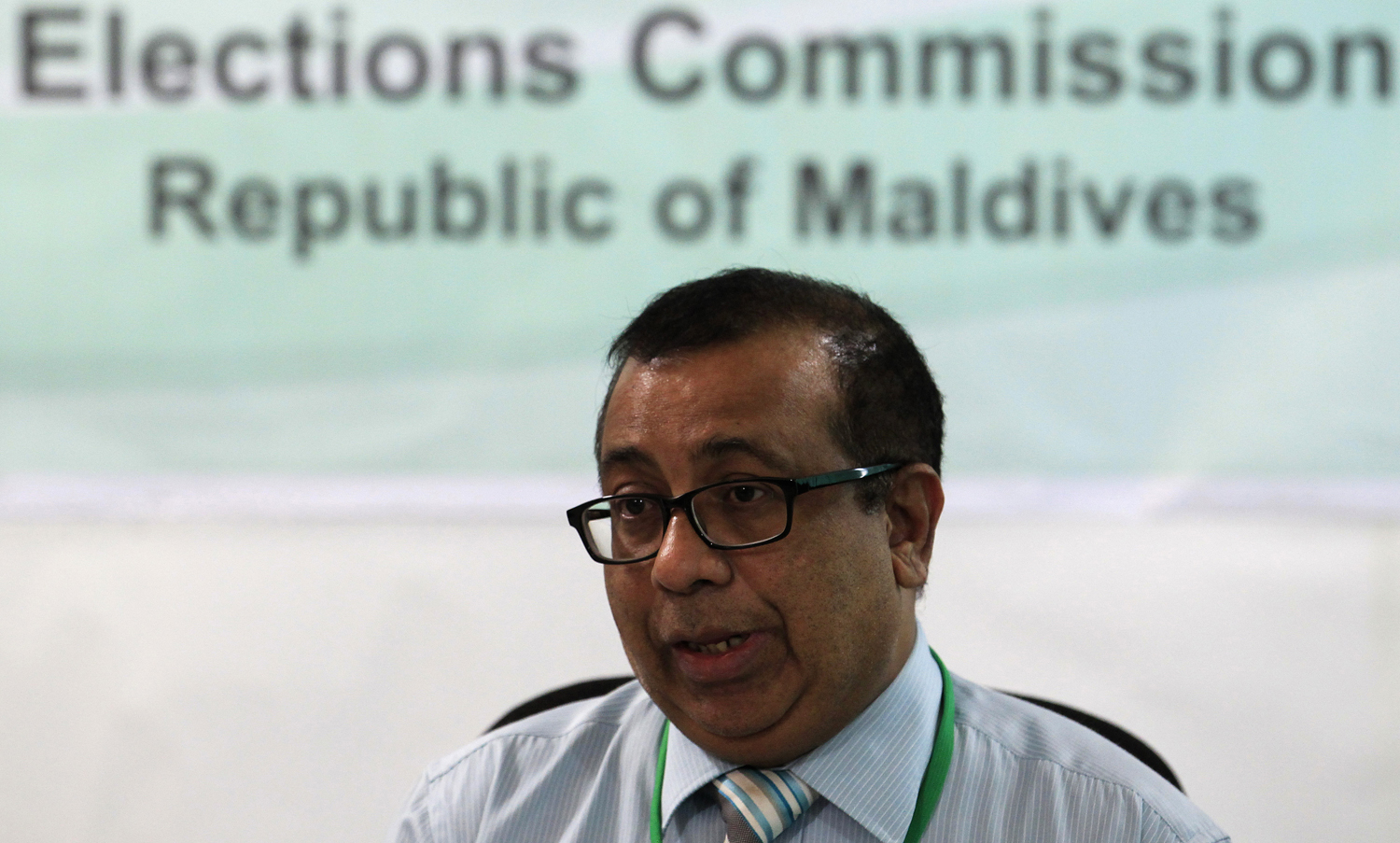 Maldives Election Commissioner Fuwad Thowfeek speaks during a news conference in Male, October 18, 2013.