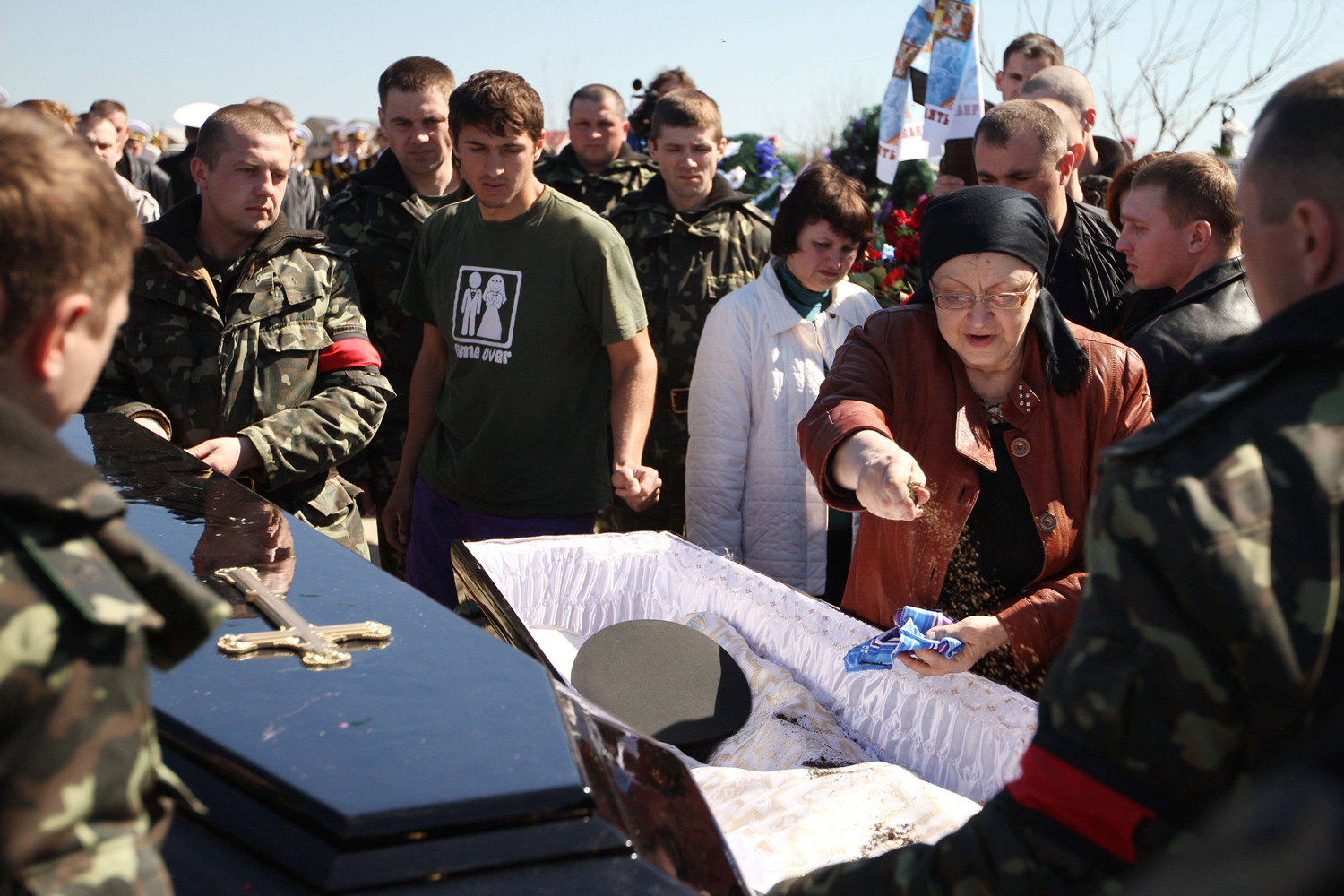 Mar. 22, 2014. People attend the funeral ceremony of Ukrainian soldier Sergey Kokurin in Simferopol.  Crimea held a joint funeral for an Ukrainian soldier and a pro-Moscow militiaman killed this week -- the first casualties since Russian forces seized the Black Sea peninsula.