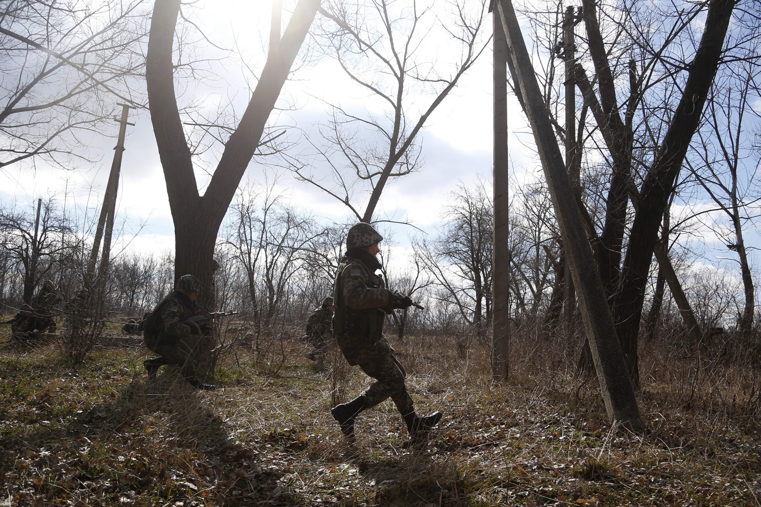 Mar. 21, 2014. Ukrainian border guards run to take their positions during training at a military camp in the village of Alekseyevka on the Ukrainian-Russian border.