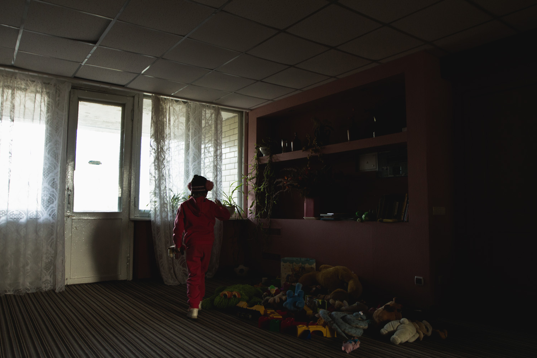 A refugee Crimean Tatar child is seen in temporary housing near Kiev.