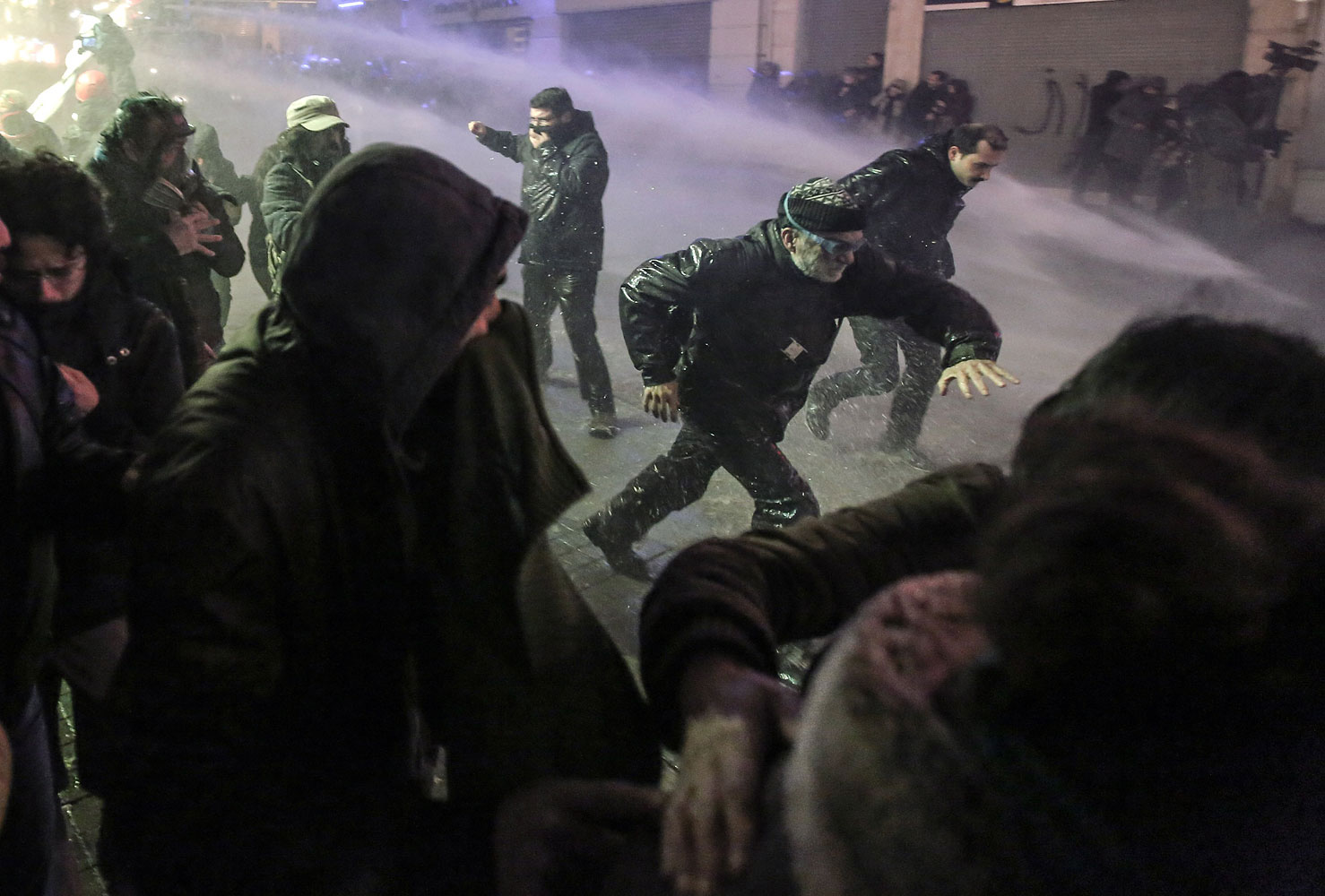 Riot police use water cannons to disperse people who protest the death of Berkin Elvan, a Turkish teenager who was in a coma since being hit in the head by a tear gas canister fired by police during the summer's anti-government protests, in Istanbul, March 11, 2014.