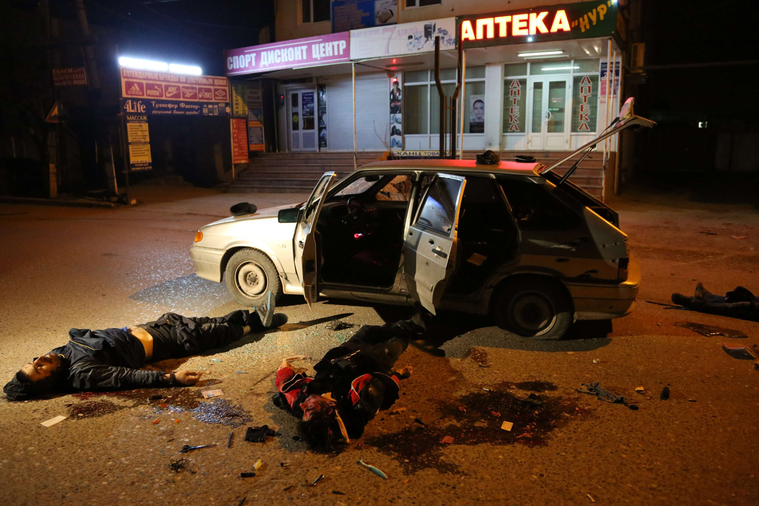 Mar. 25, 2014.                               Bodies of suspected rebels killed in a shootout with police officers lie near their car in the town of Khasavyurt in Dagestan, Russia.