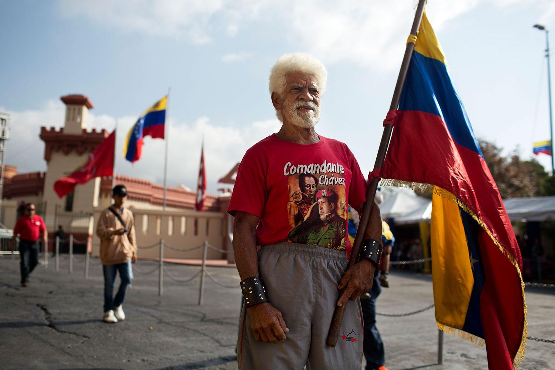 Pablo de la Cruz Aldana poses for a photo after visiting the mausoleum of the late Venezuelan President Hugo Chavez in Caracas, March 5, 2014.