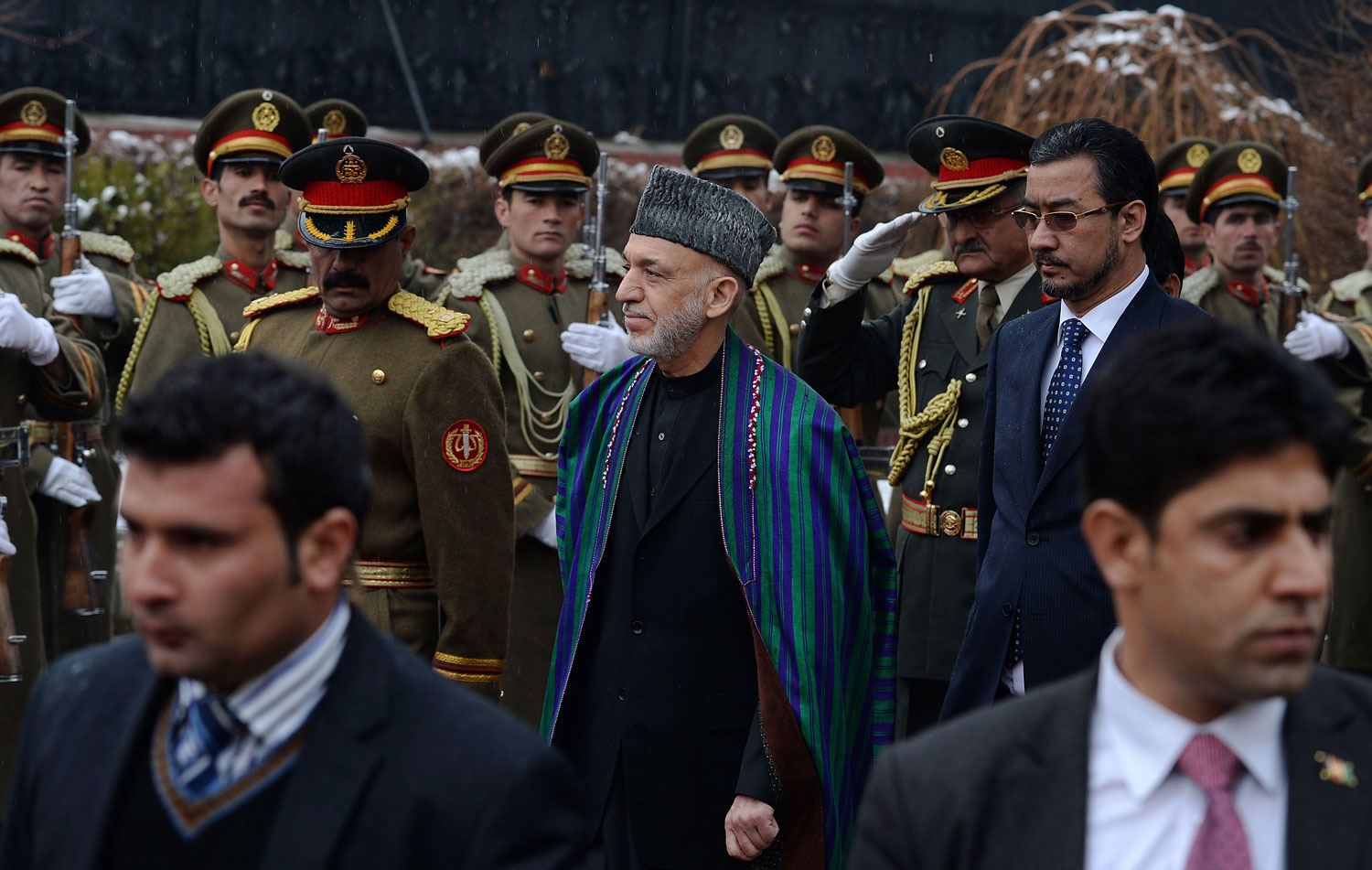 Afghan President Hamid Karzai, center, inspects a guard of honour as he arrives to deliver his final address in parliament in Kabul on March 15, 2014.