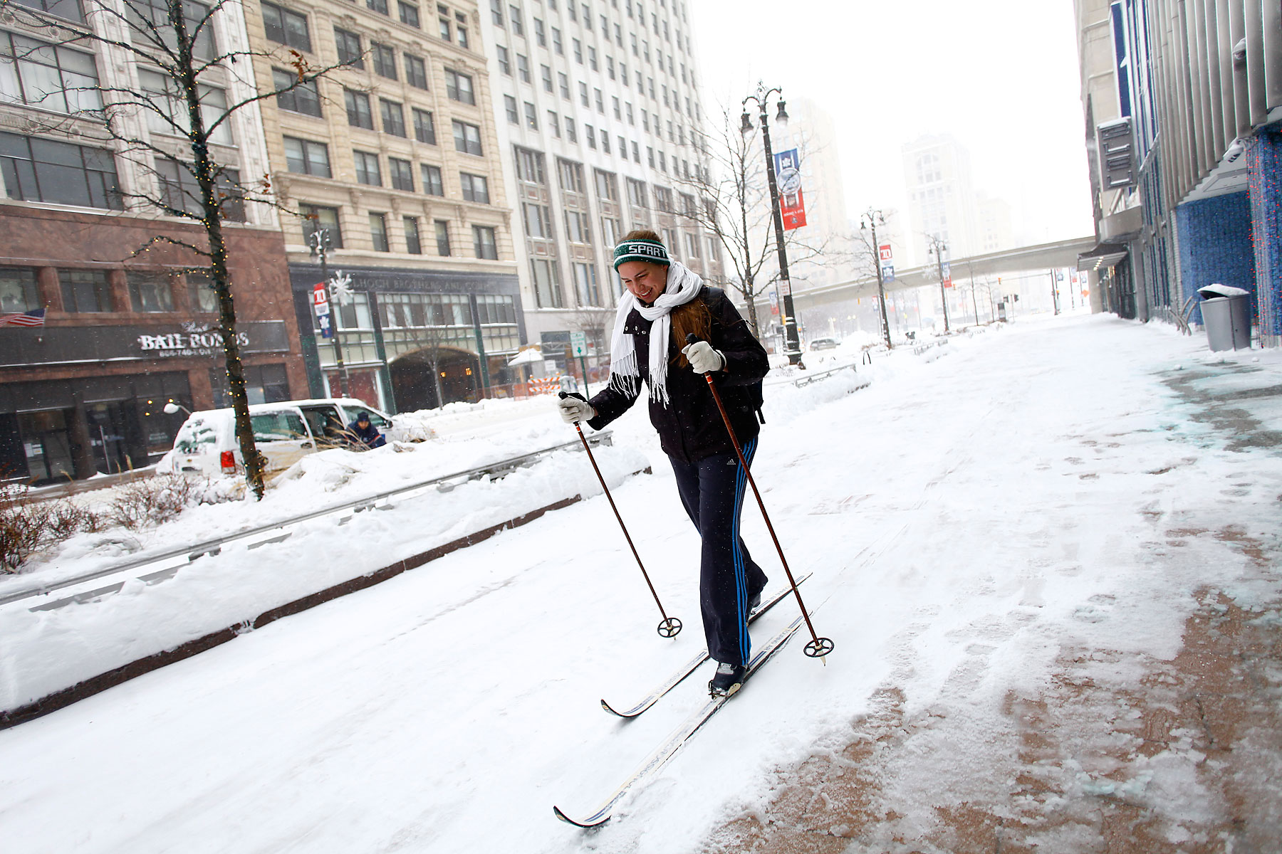 Alison Mueller skies to work through several inches of snow along Woodward Avenue as the area deals with record breaking freezing weather January 6, 2014 in Detroit, Michigan.