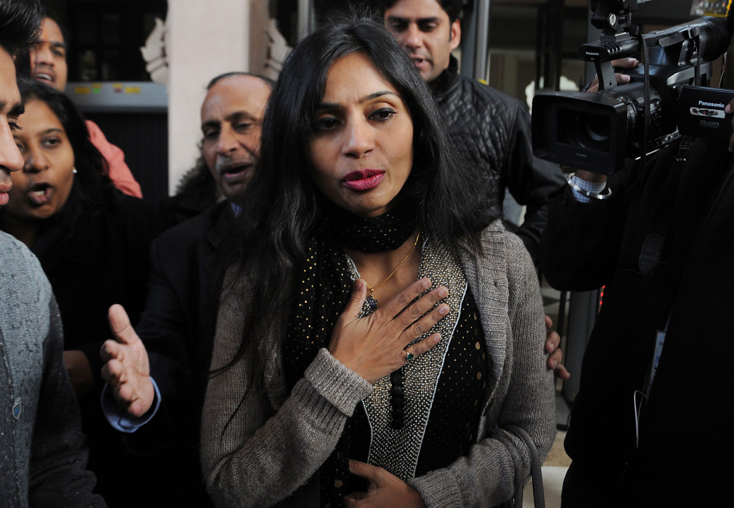 Indian diplomat Devyani Khobragade (C) leaves her guest house to meet with Indian Minister for External Affairs, Salman Khurshid in New Delhi on January 11, 2014.