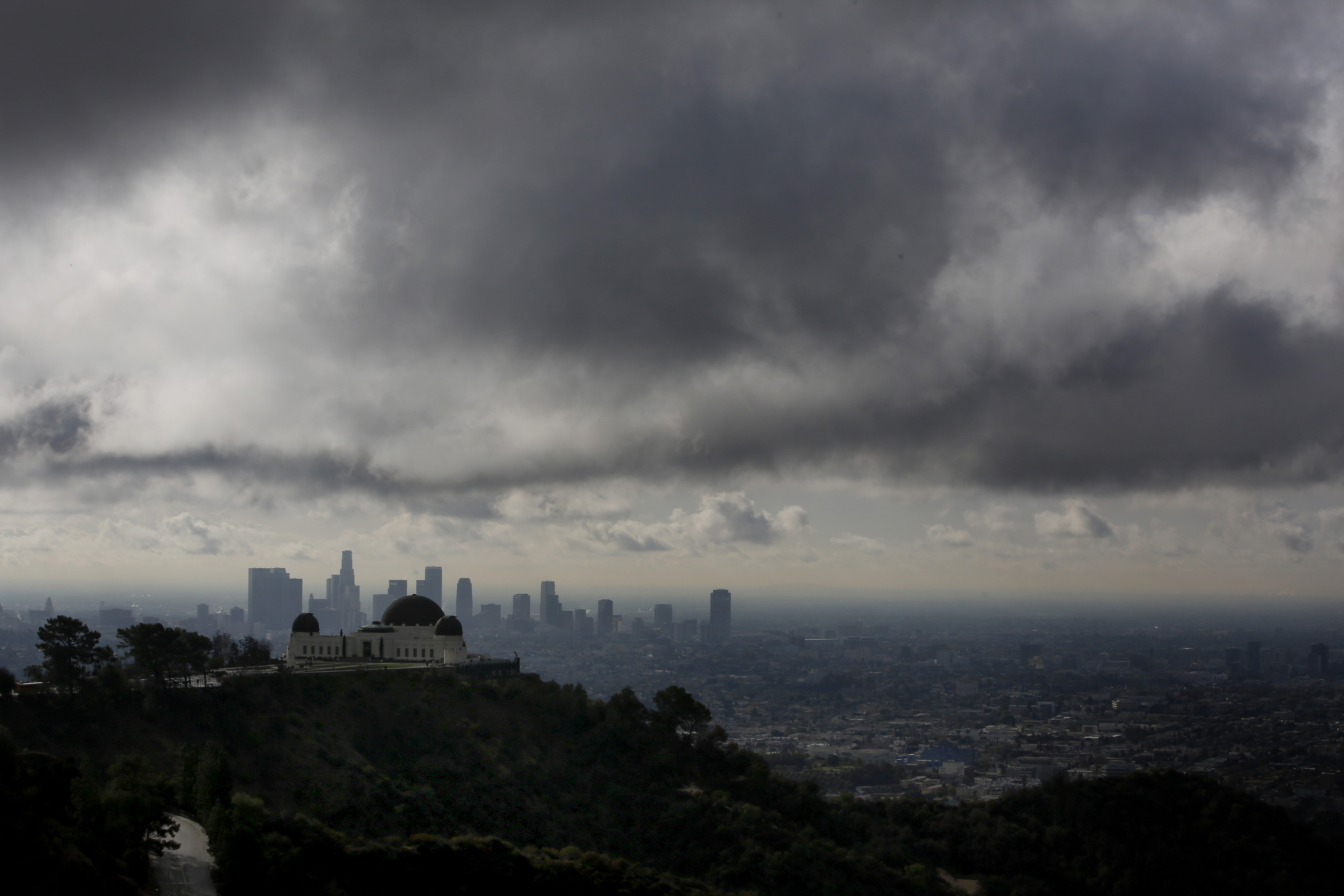 The Griffith Observatory is seen as clouds gather above the skyline of Downtown Los Angeles in Los Angeles, California, U.S., on Thursday, Feb. 27, 2014.