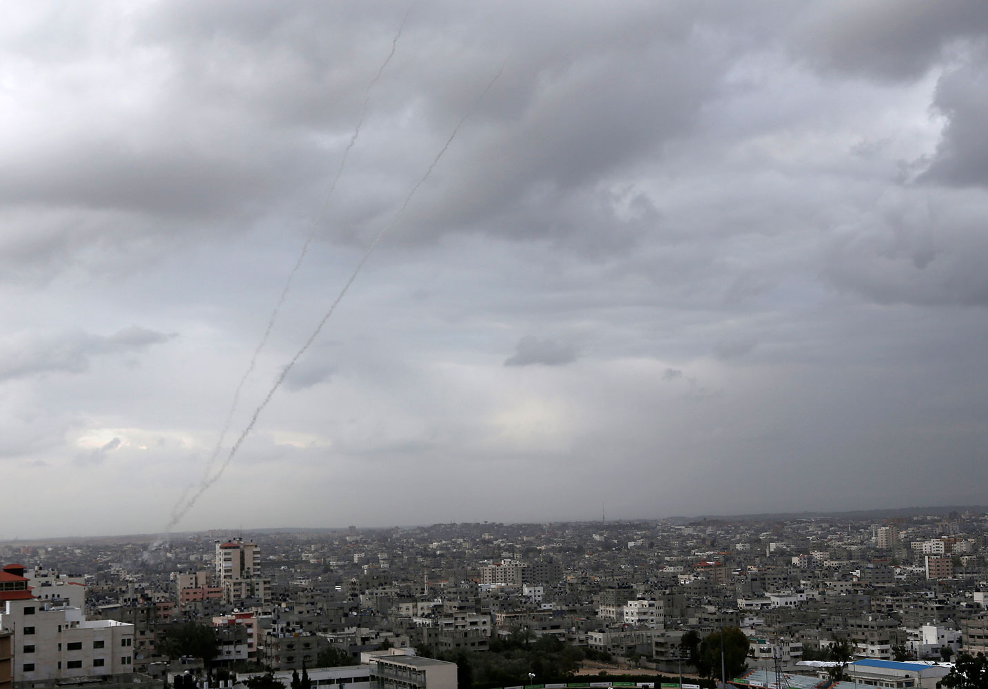 A trail of smoke from rockets fired by Palestinian militants from Gaza toward Israel is seen above Gaza City on March 12, 2014.