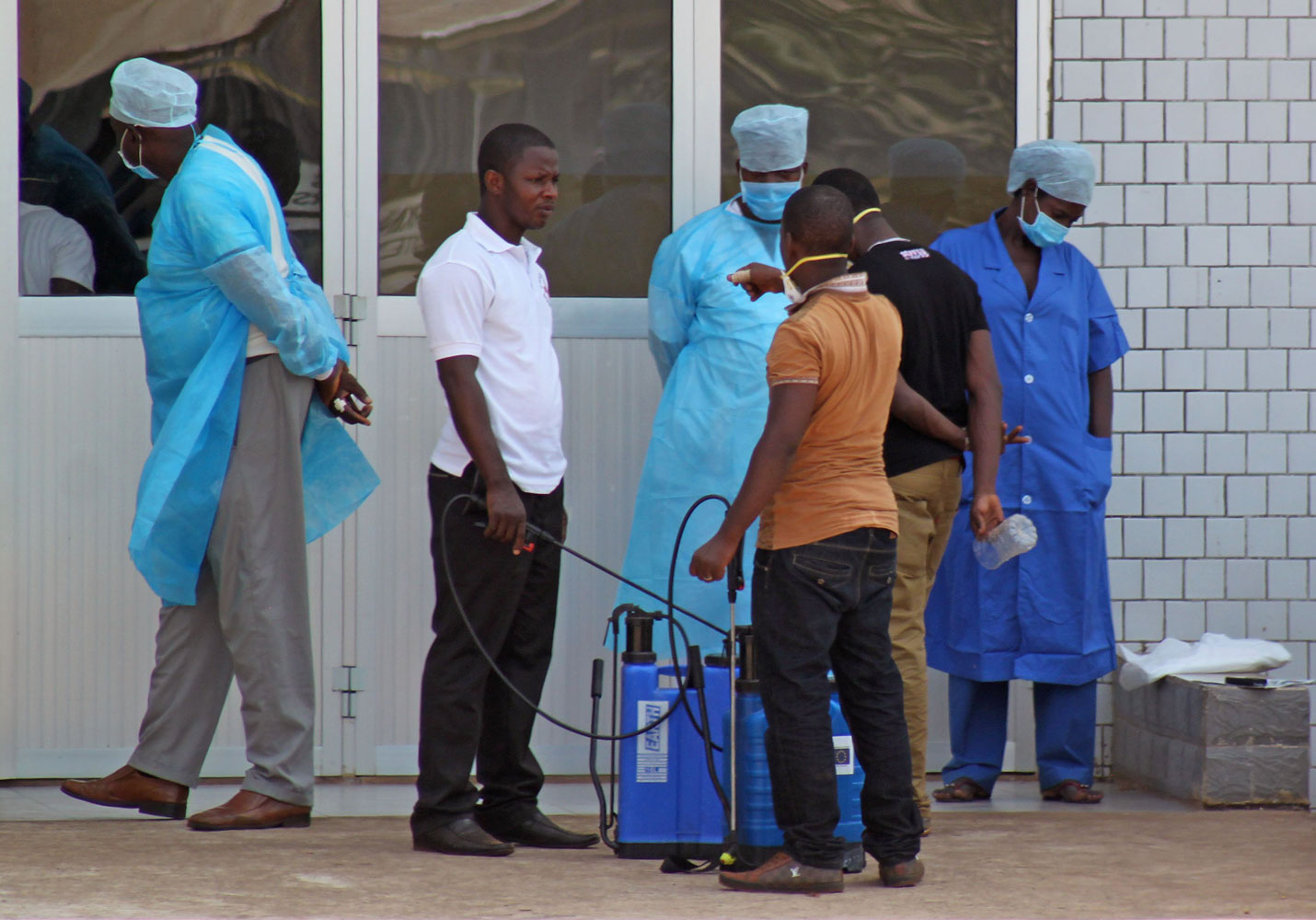 Medical personnel at the emergency entrance of a hospital receive suspected Ebola virus patients in Conakry, Guinea, March 29, 2014.