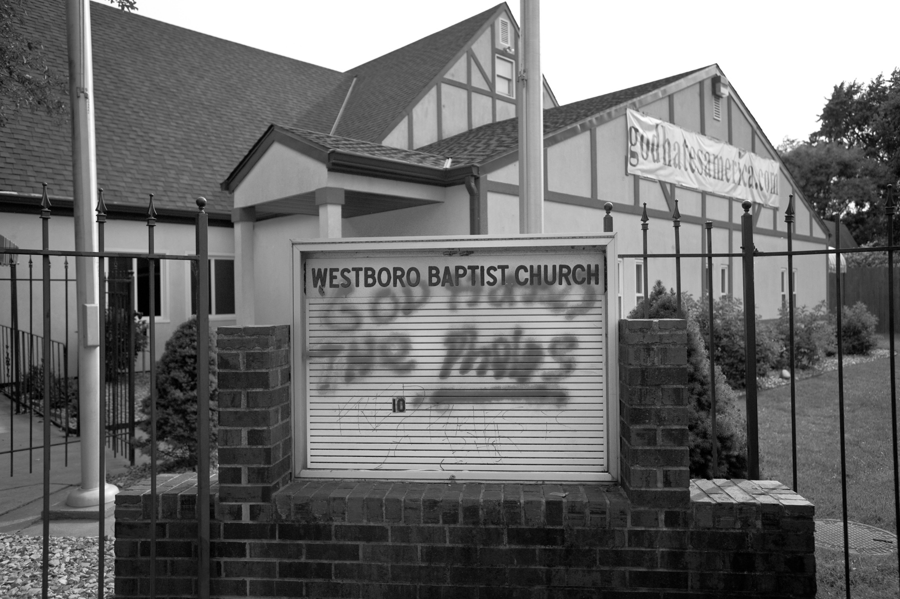 Graffiti defaces the sign of the Westboro Baptist Church.