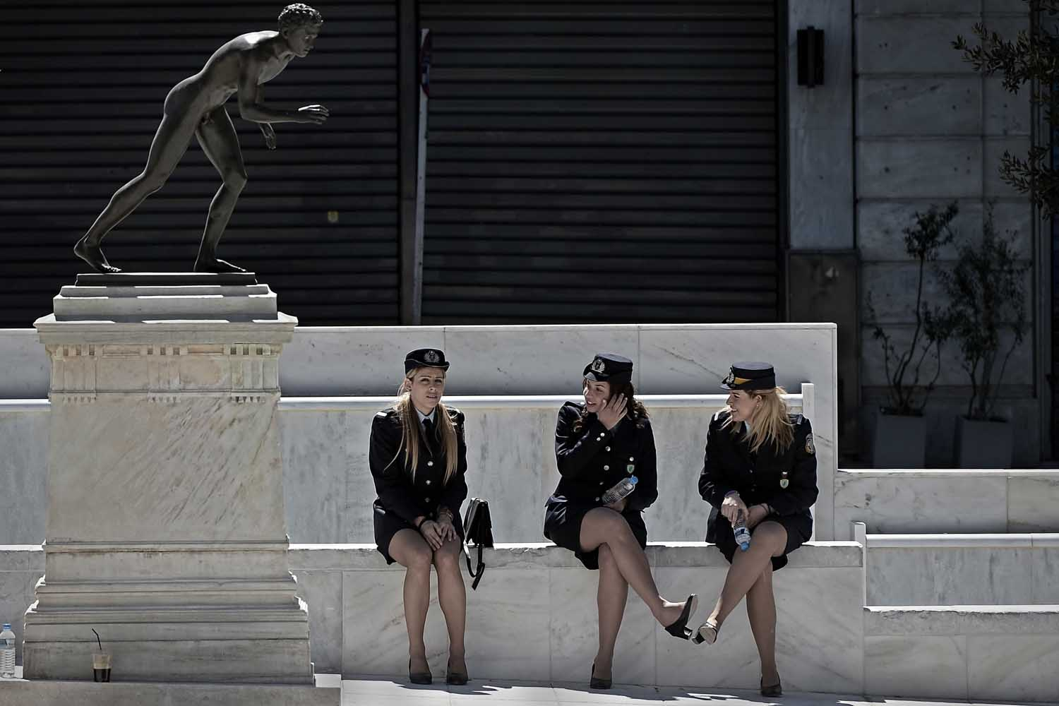 Mar. 25, 2014.                                Police women rest after a military parade marking the Greek Independence Day in Athens.