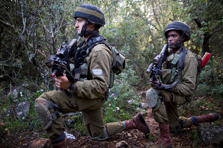 Israeli Defense Forces (IDF) soldiers are seen during warfare training in Israel's northern El Yakim base, Feb. 27, 2014.
