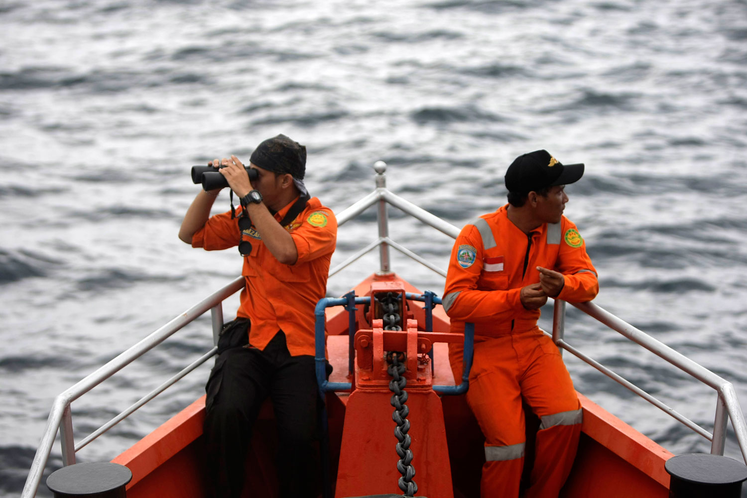 Indonesian Search And Rescue (SAR) personnel keep a lookout on a rescue ship that is heading to the Andaman sea conducting a search operation for the missing Malaysian Airlines plane flight MH370, in the Indian Ocean, near the tip of Sumatra Island, Indonesia, March 15 2014.