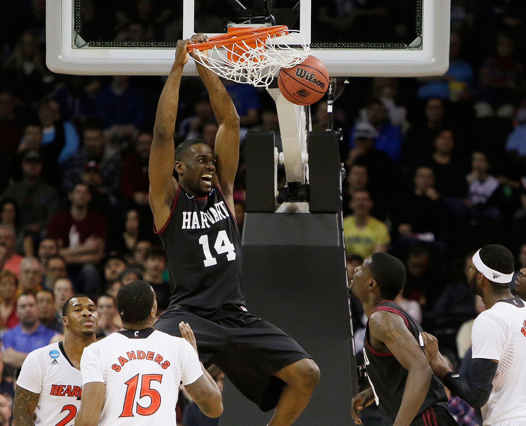 Harvardís Steve Moundou-Missi dunks against Cincinnati in the second half during the second-round of the NCAA men's college basketball tournament in Spokane, Wash., March 20, 2014.